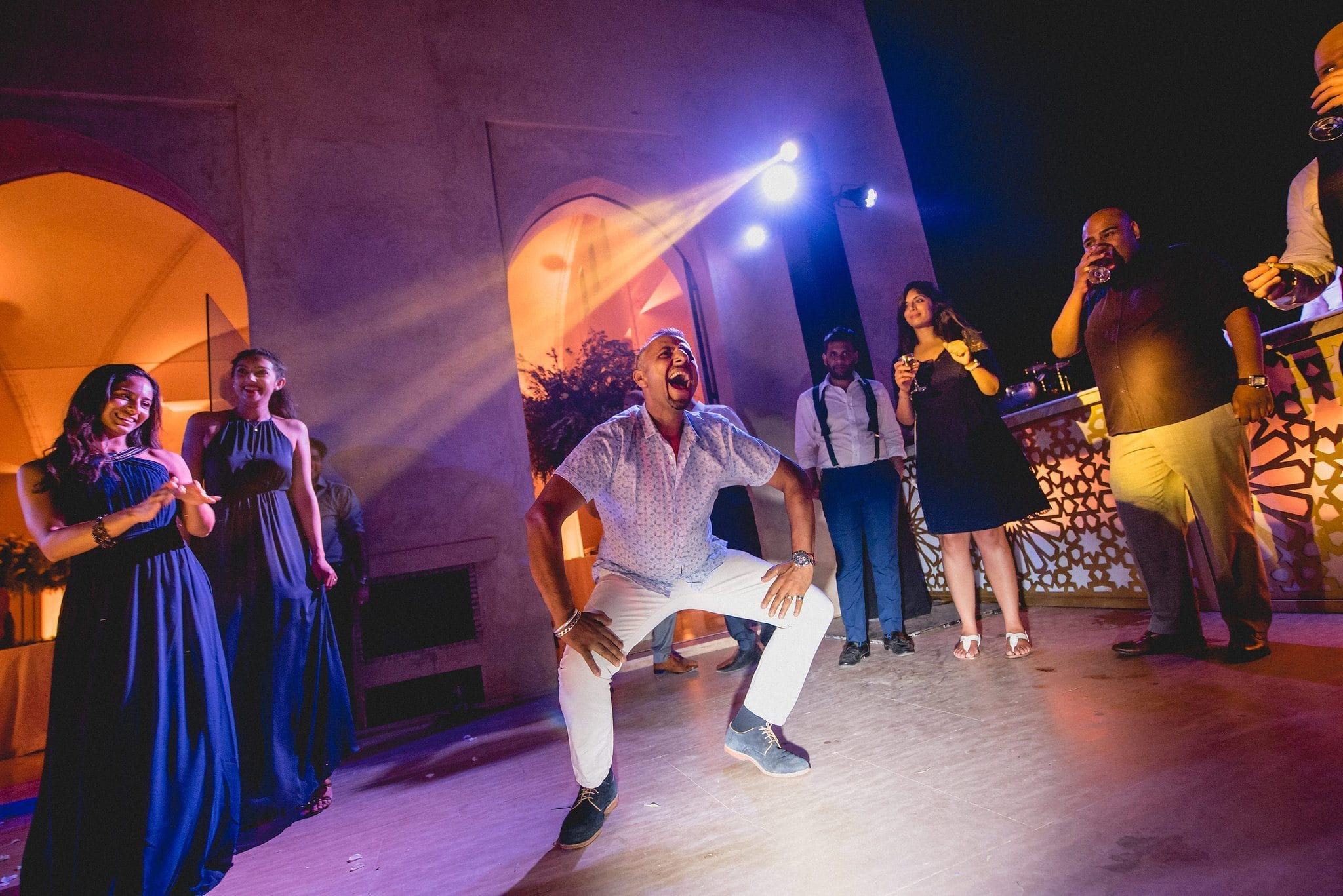 A male wedding guest shows off some dance moves