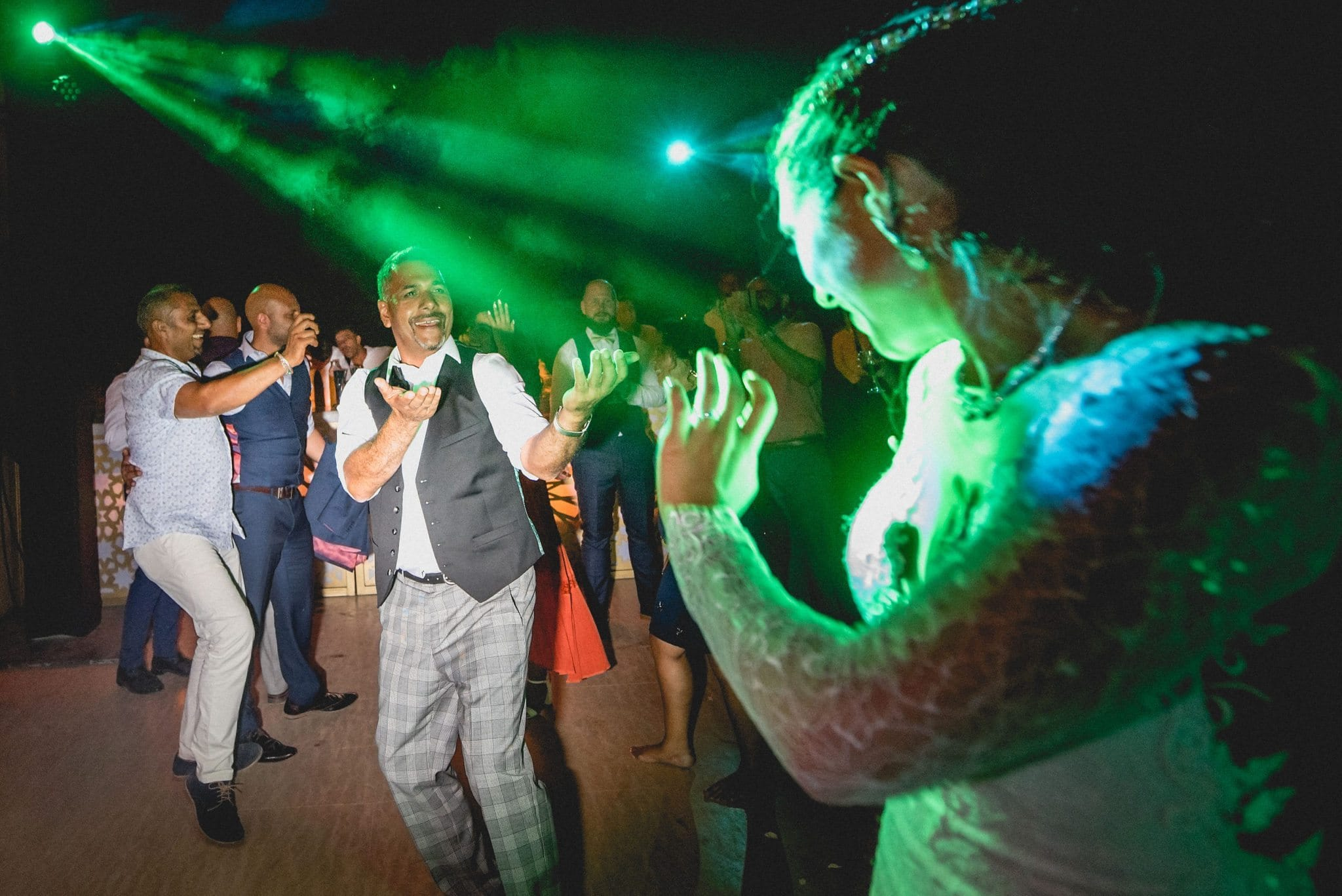 Bride and her dad dancing happily at Ksar Char Bagh
