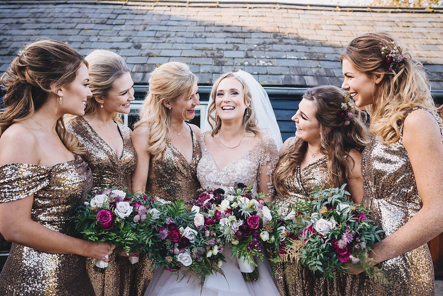 The bride stands with her four bridesmaids