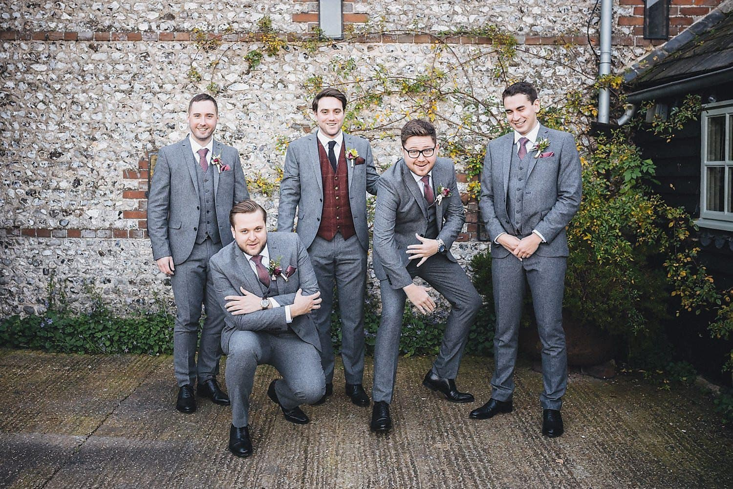 A funny group shot of the groom and groomsmen
