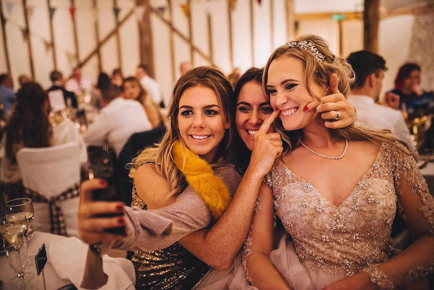 Bride taking selfie with her Upwaltham Barns wedding guests