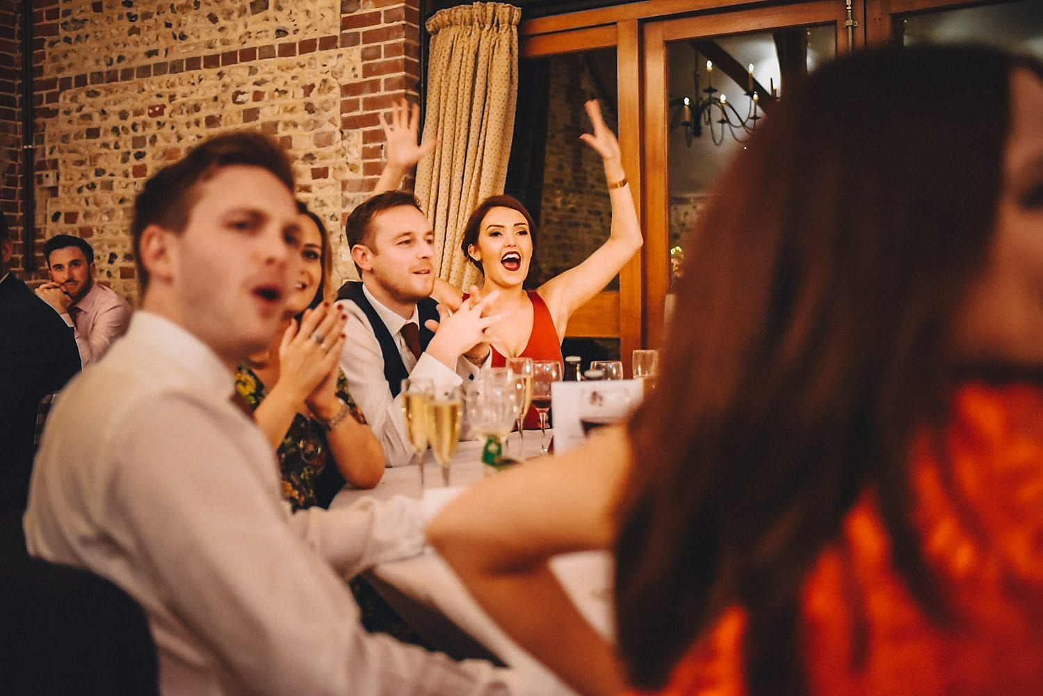 Guests applaud and wave their arms during the speeches. Woop woop!