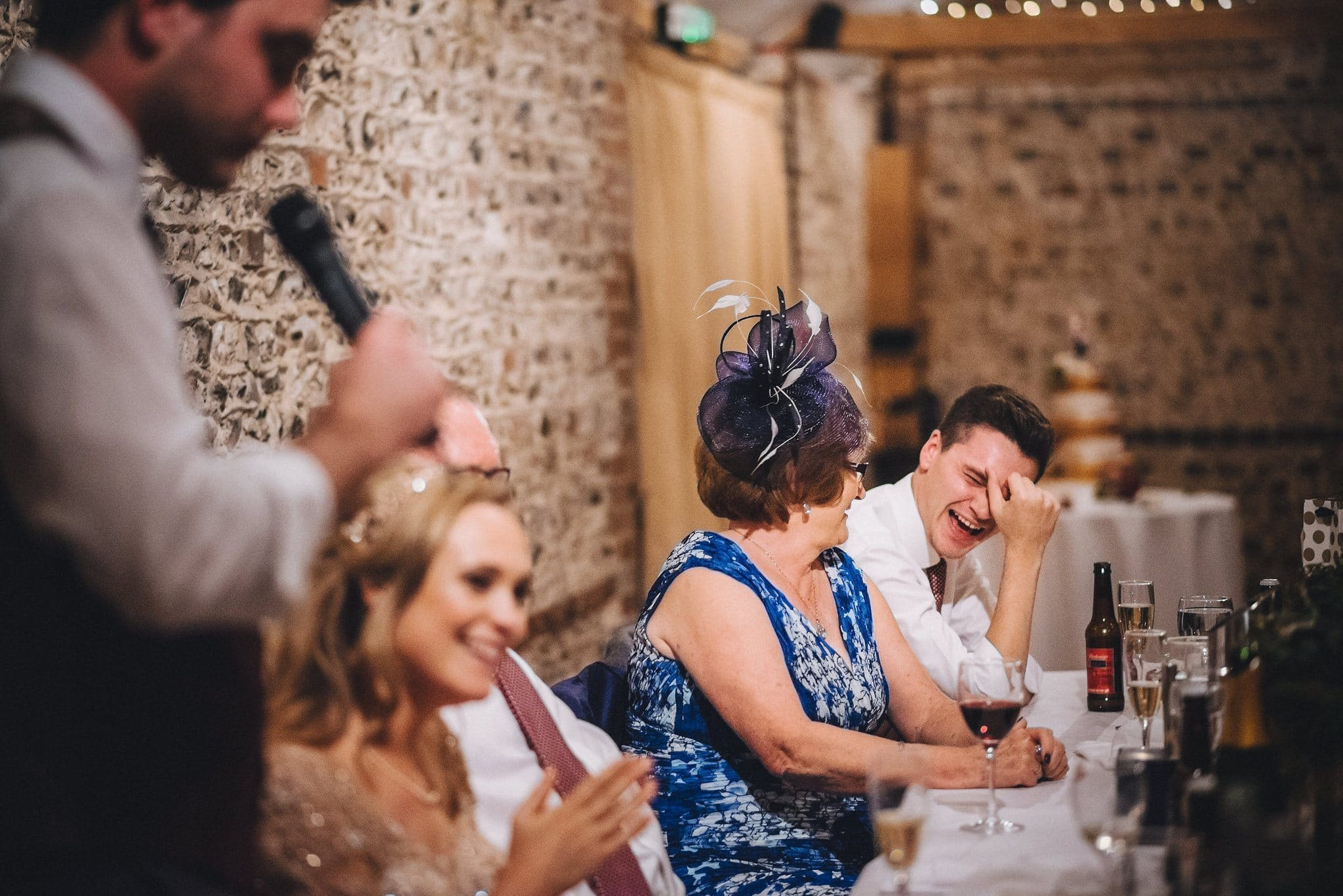 Bride's brother laughing at the wedding speeches