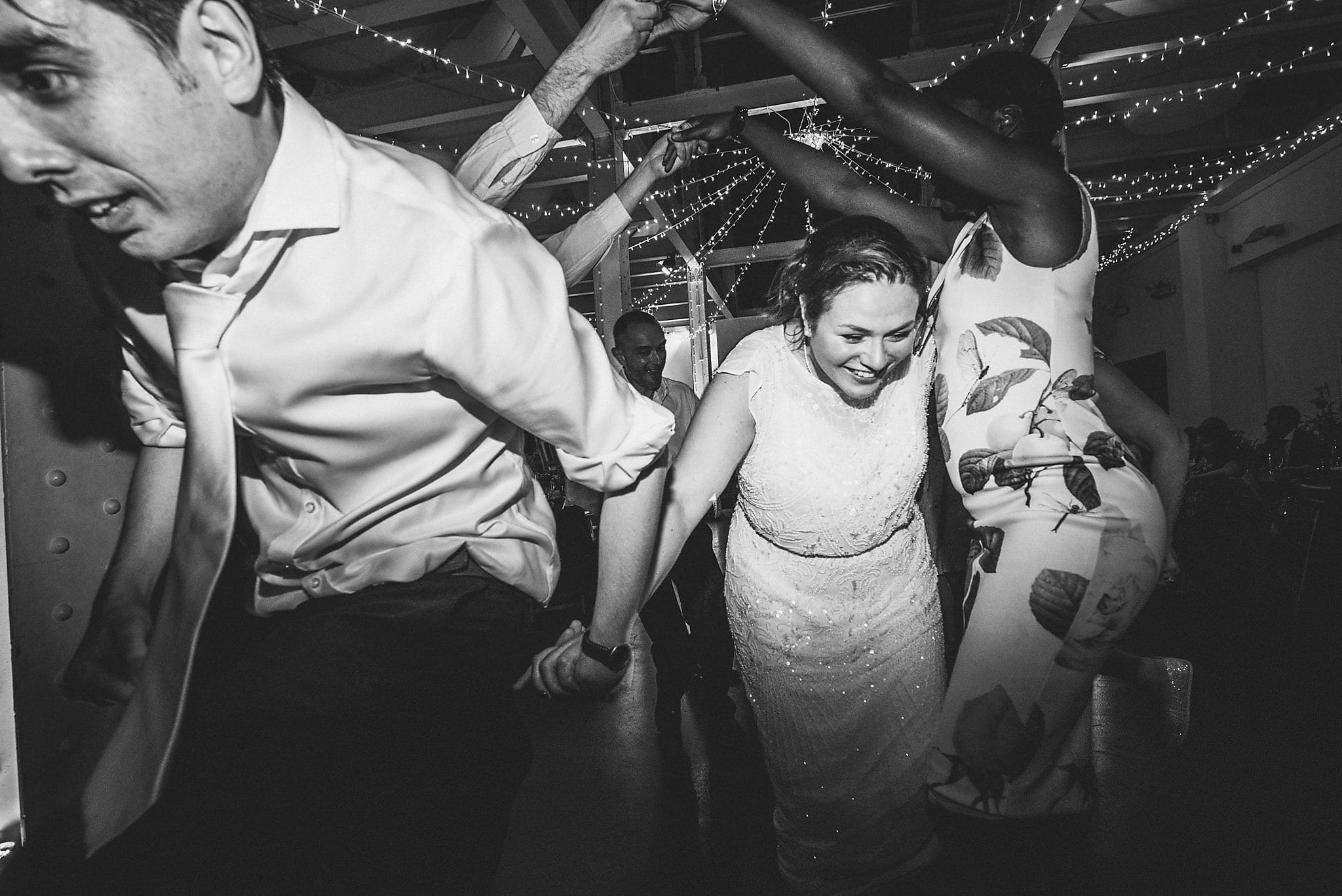 Bride and Groom dancing the Ceilidh at their West Reservoir Centre Wedding