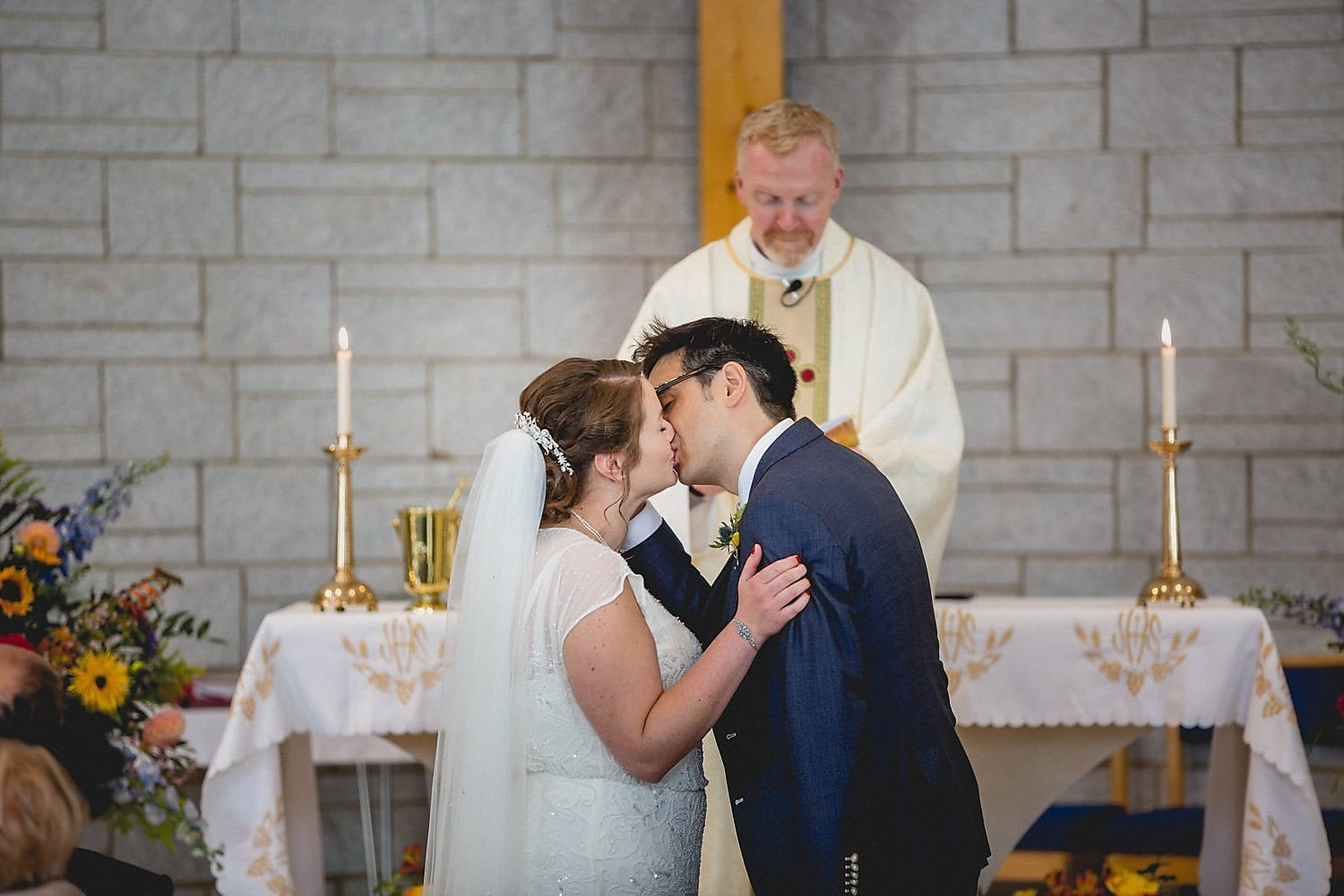 The newlyweds share their first kiss as husband and wife