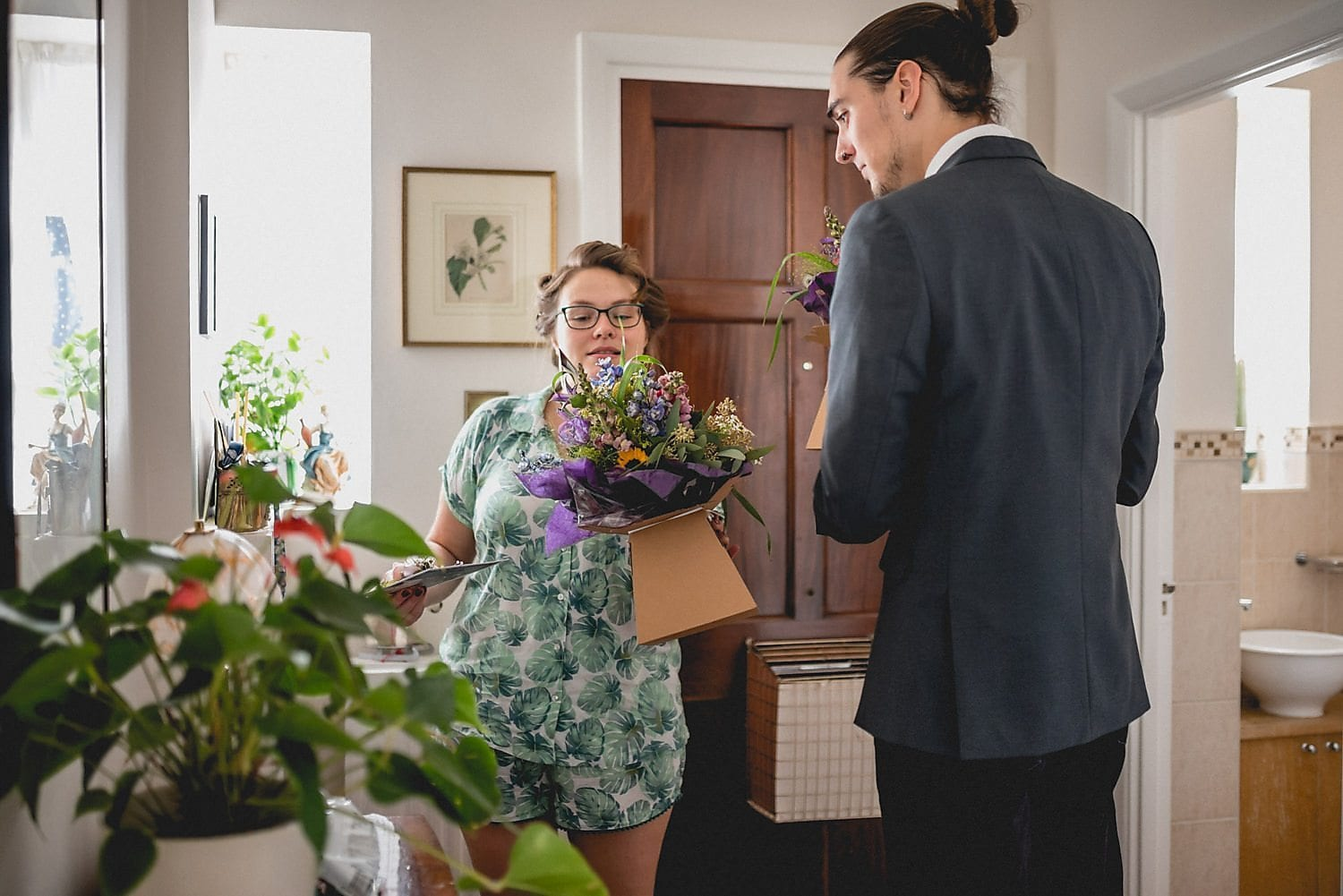 Bride Elizabeth checks over her bouquet as it's dropped off at her house