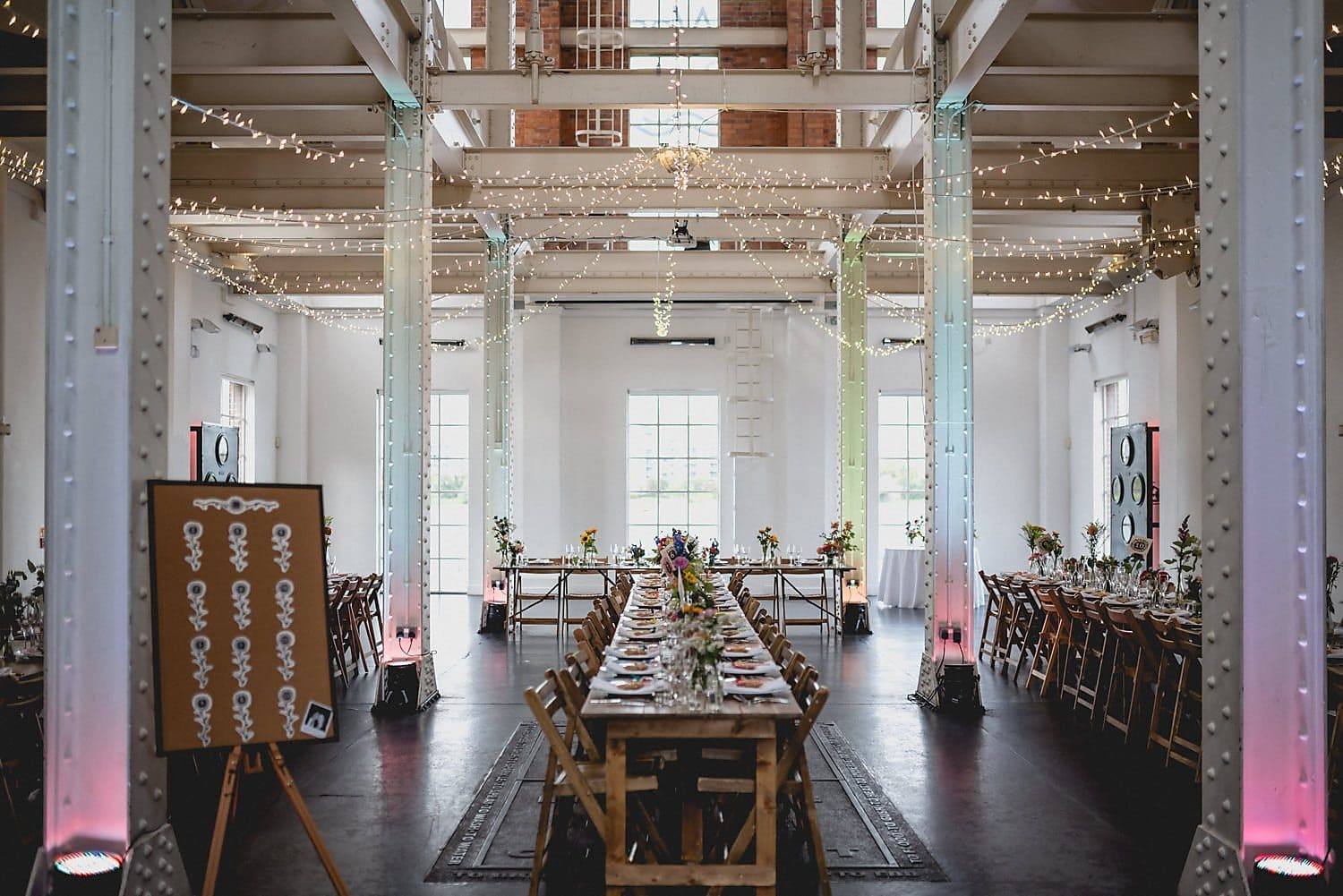 Internal shot of West Reservoir Centre with trestle tables and festoon fairy lights