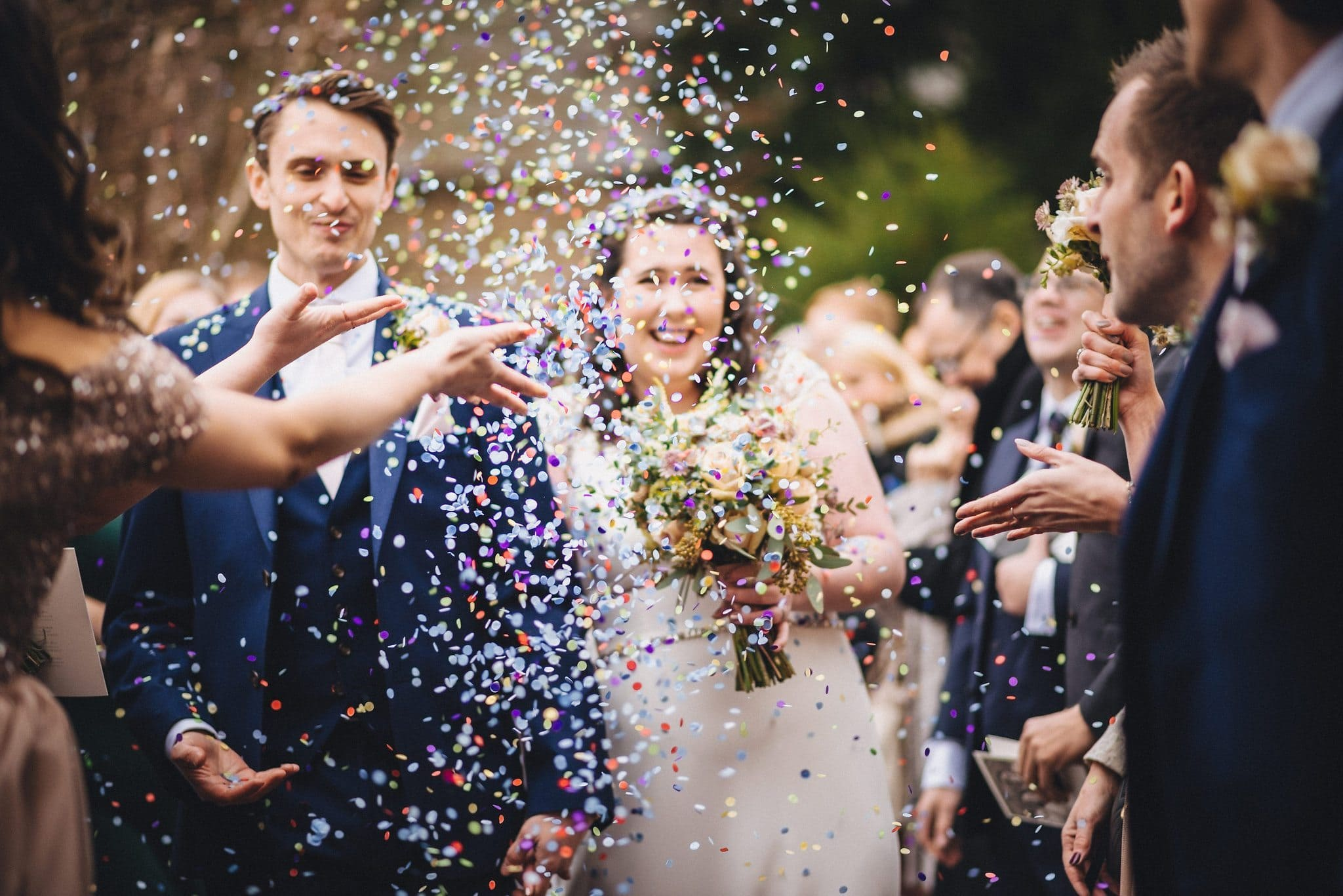 Colourful confetti storm at a Lyde Court Winter Wedding