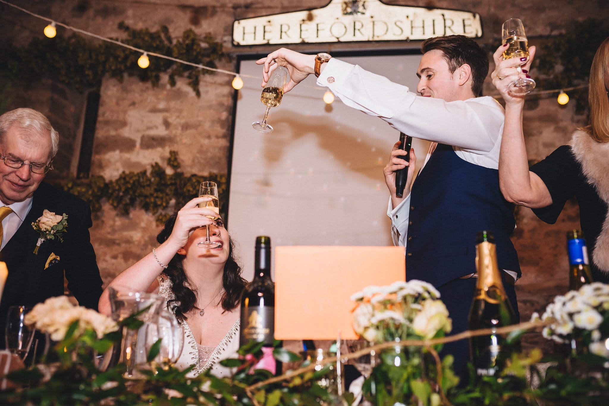 Bride and groom raise glasses to each other