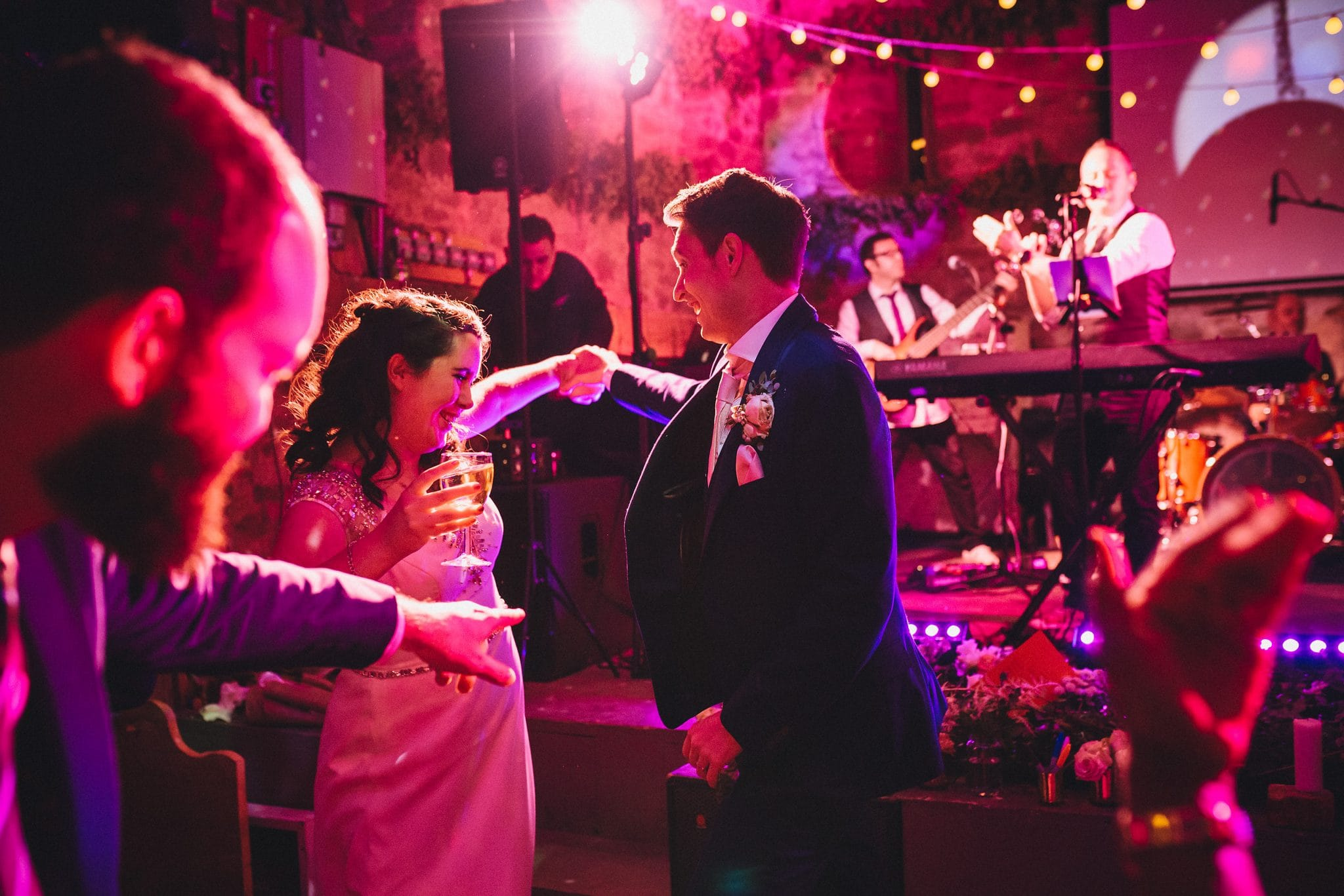 Groom twirls his bride on the dance floor at Lyde Court
