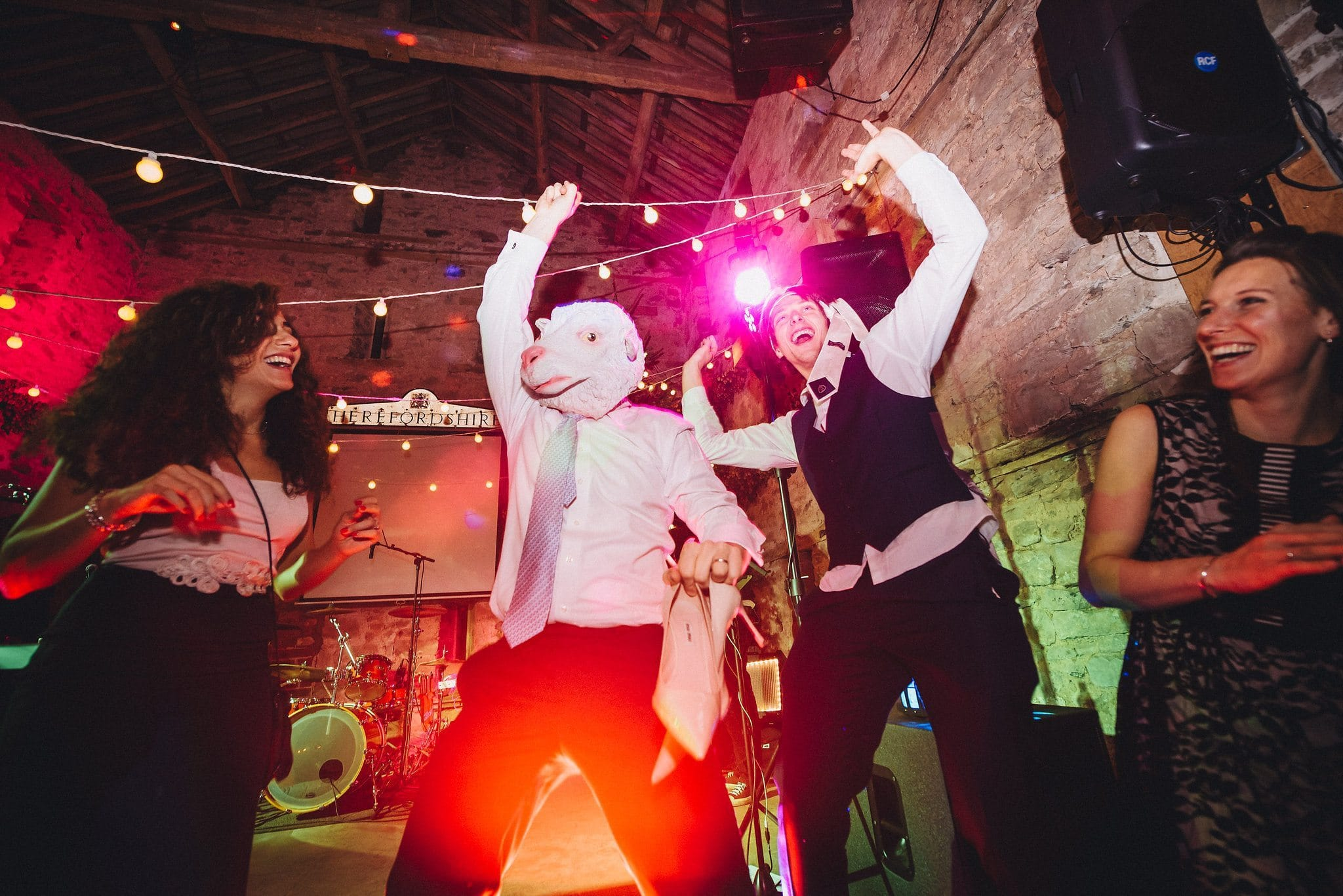 Man in sheep's head mask on the dance floor