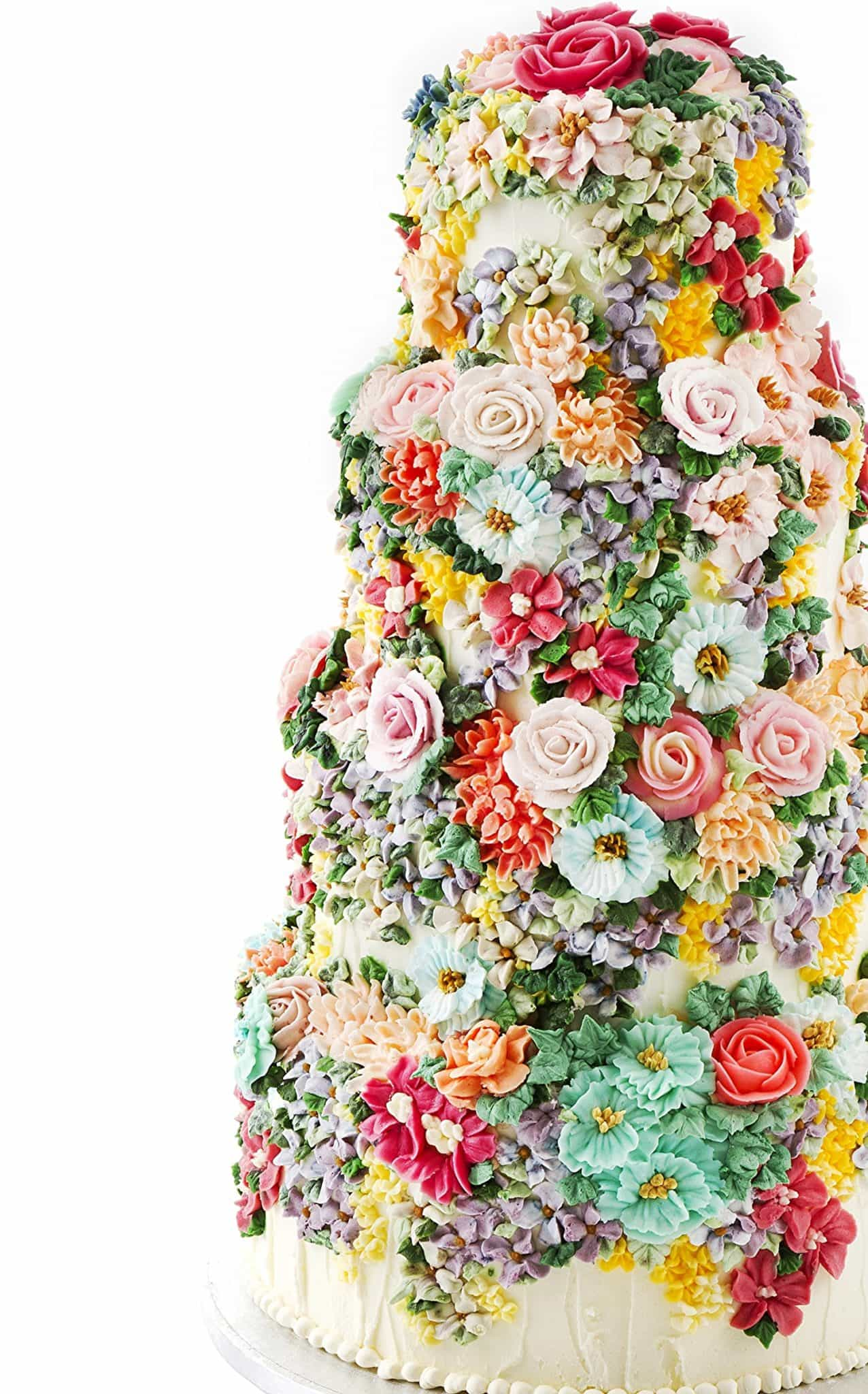 Buttercream wedding cake by Emma Page covered in colourful piped buttercream flowers
