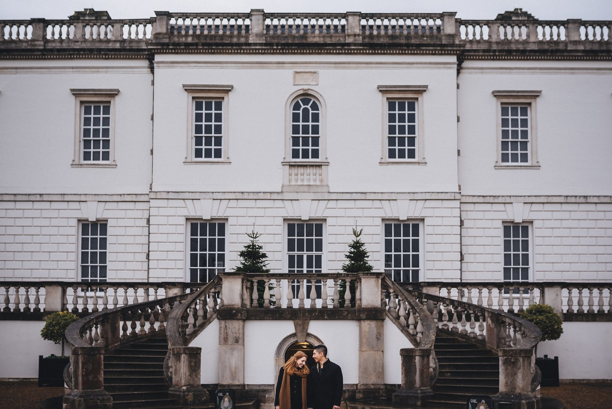 Engaged couple laughing together on their Greenwich Engagement Shoot