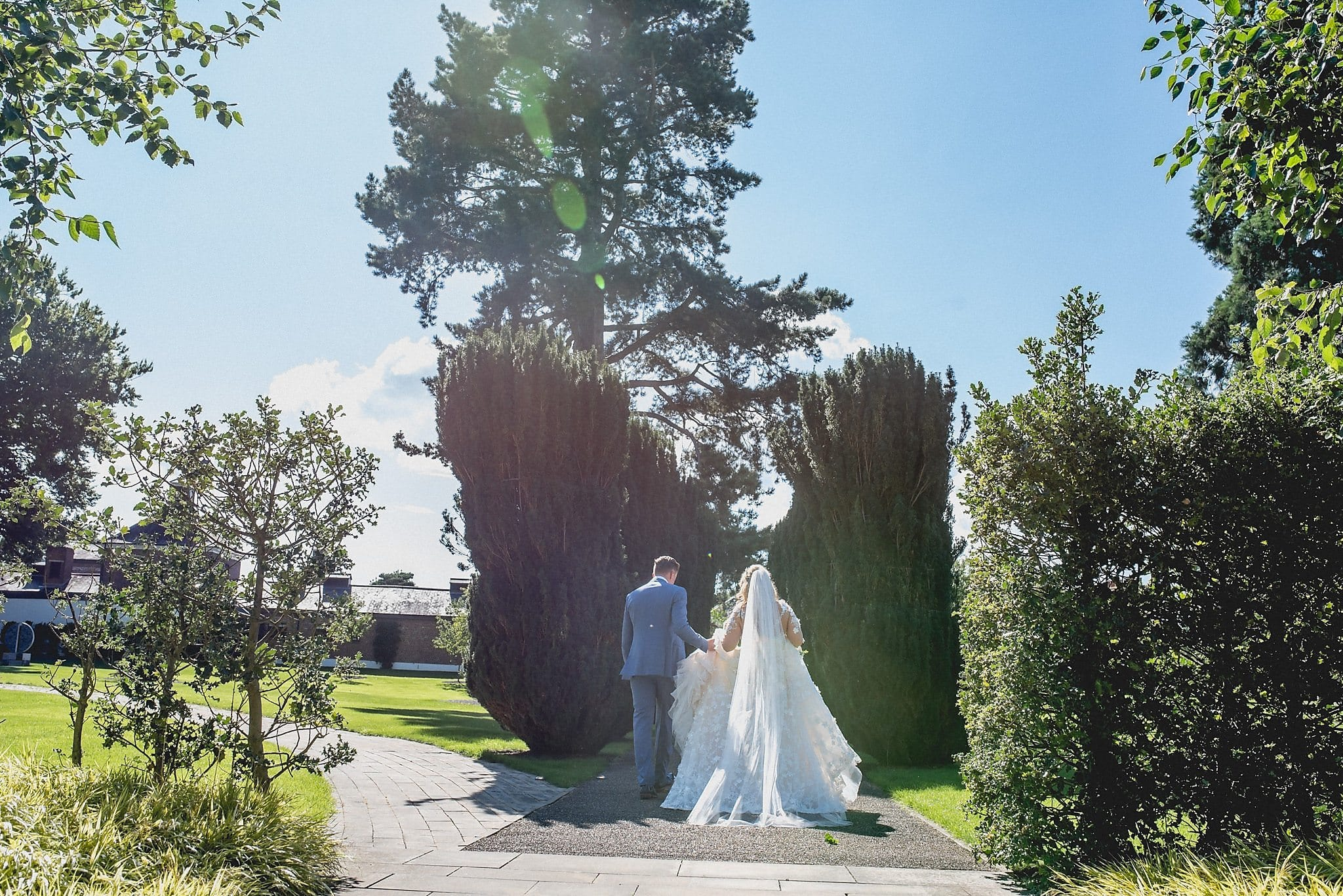 Bride and groom go for a walk in the gardens.