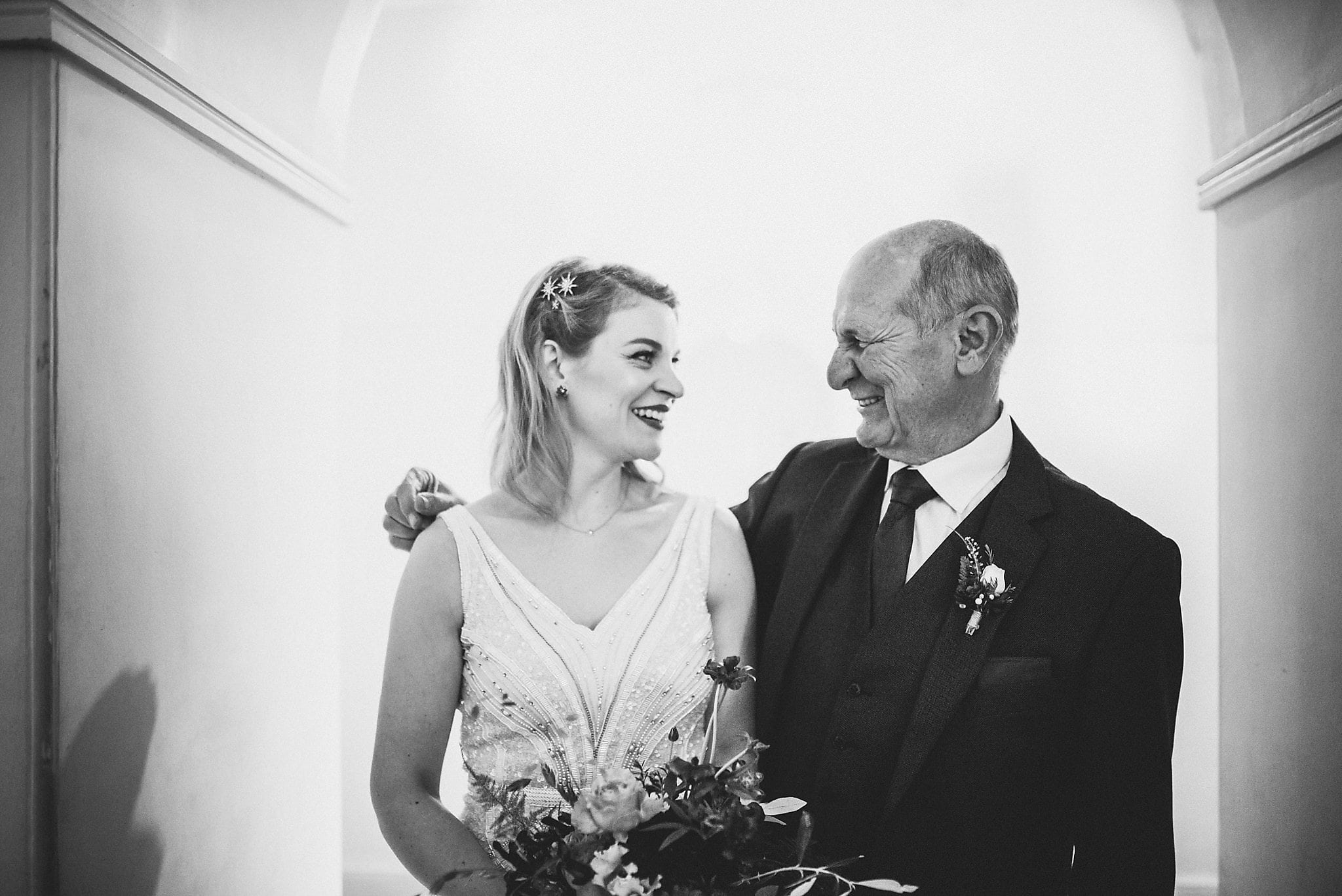 Bride and Father of the bride sharing a smile at her Clissold House Wedding