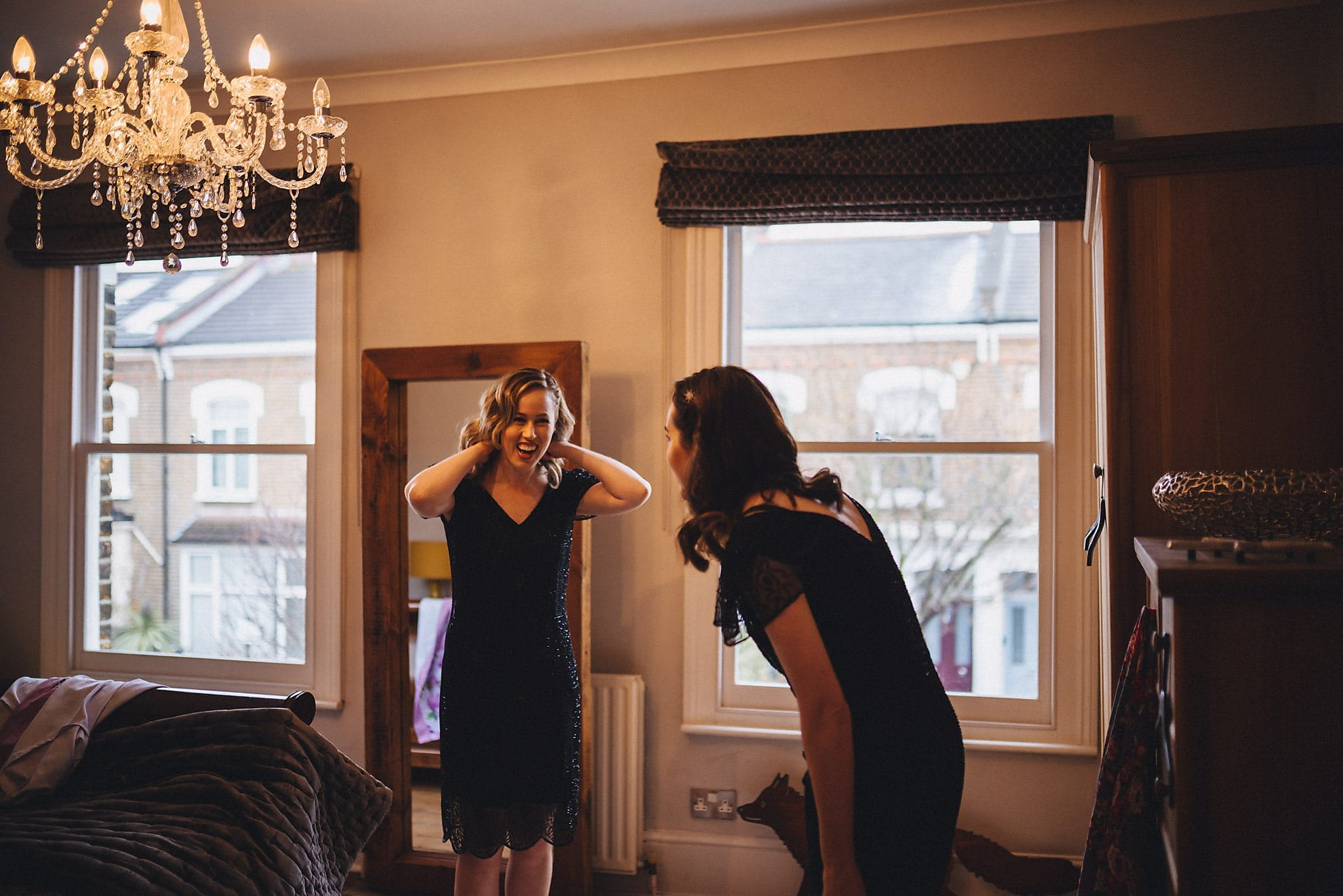 Bridesmaids in navy sequinned dresses getting ready