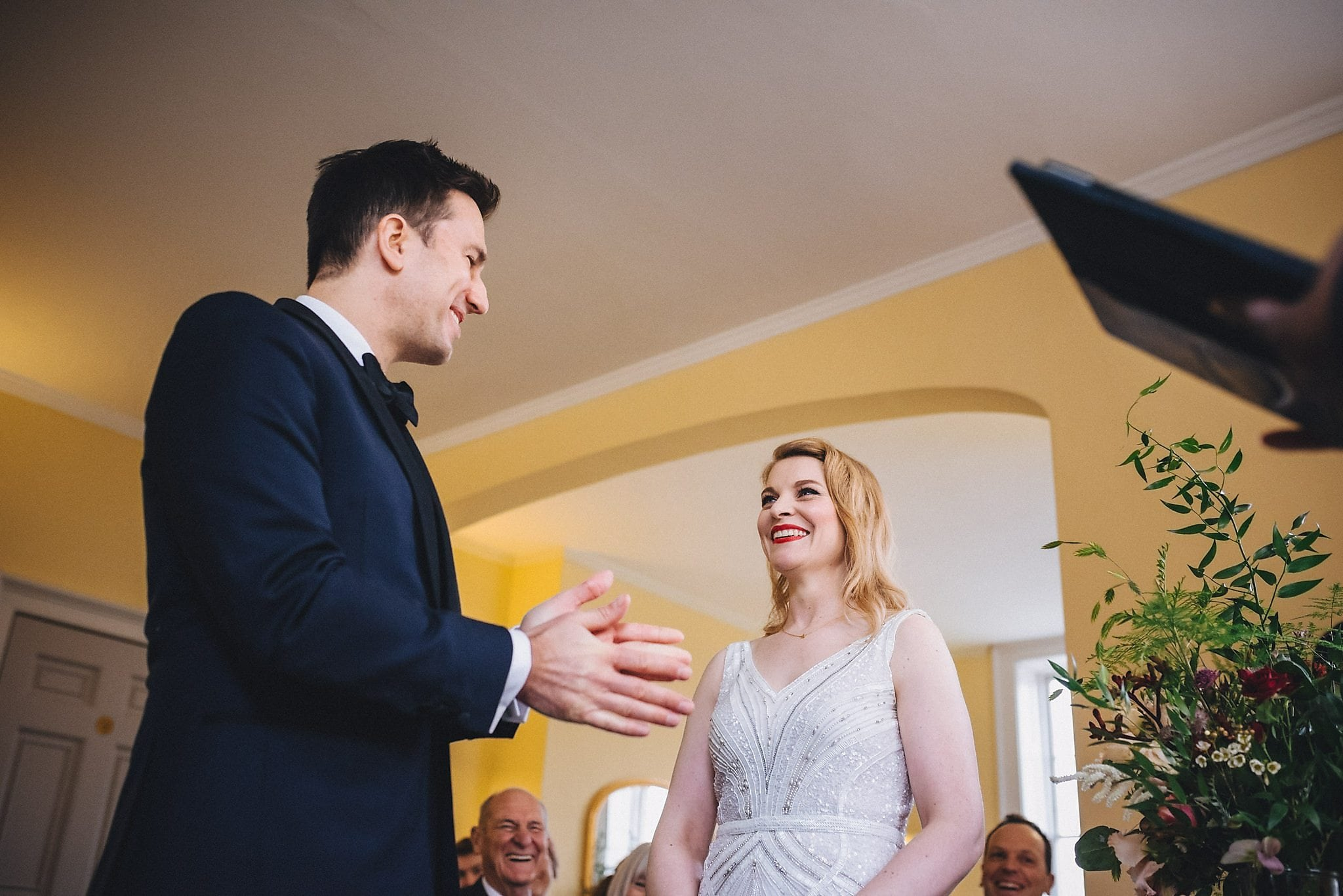 Couple exchanging wedding vows at their Clissold House wedding ceremony