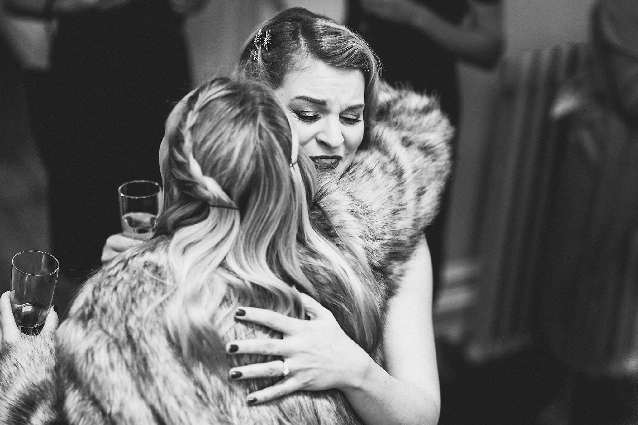 Bride hugging a wedding guest at her Clissold House Wedding
