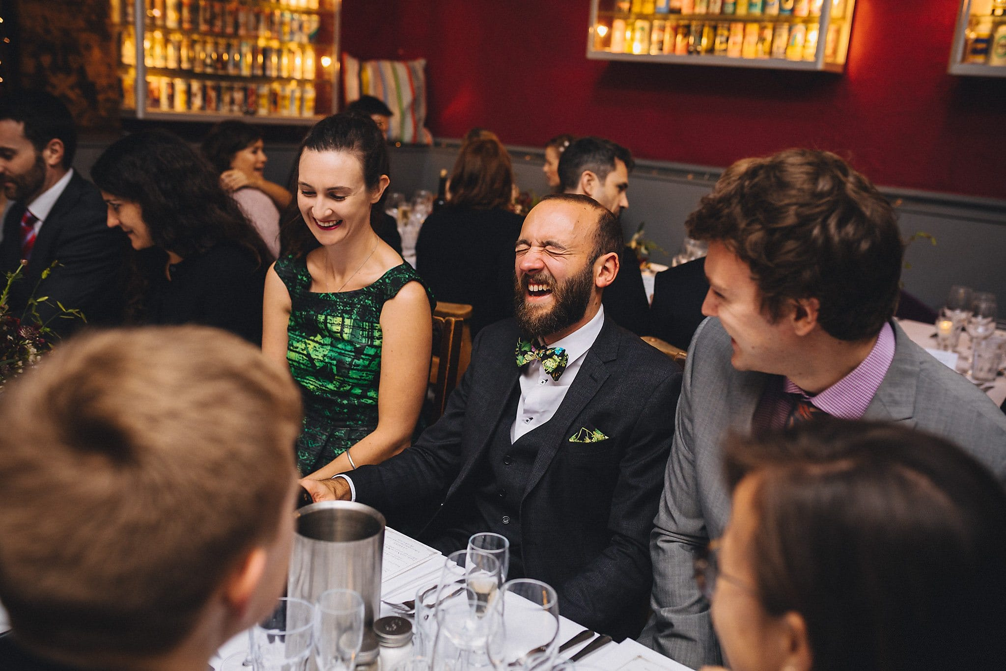 Guests laughing at wedding reception
