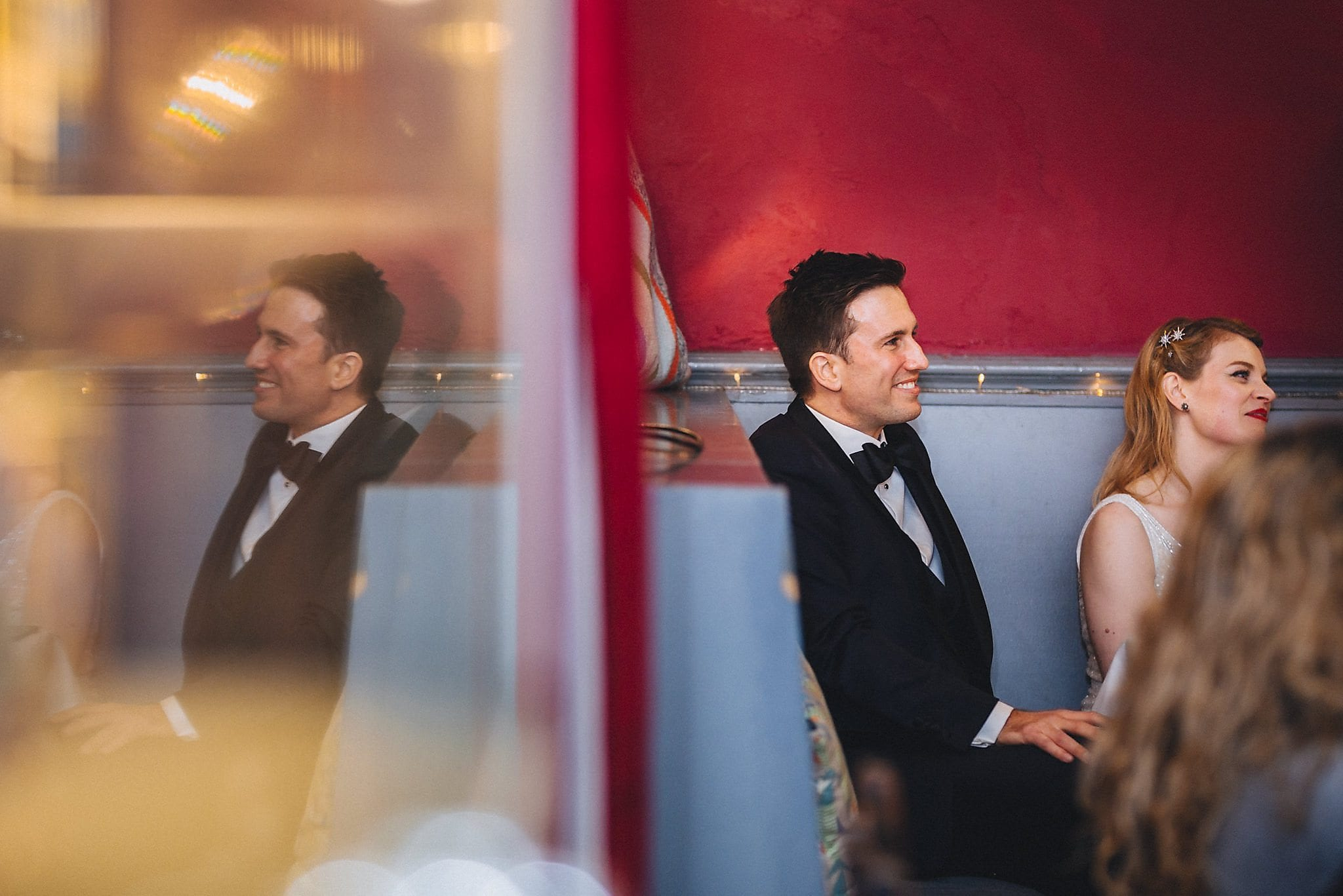 Groom and bride listen to speeches