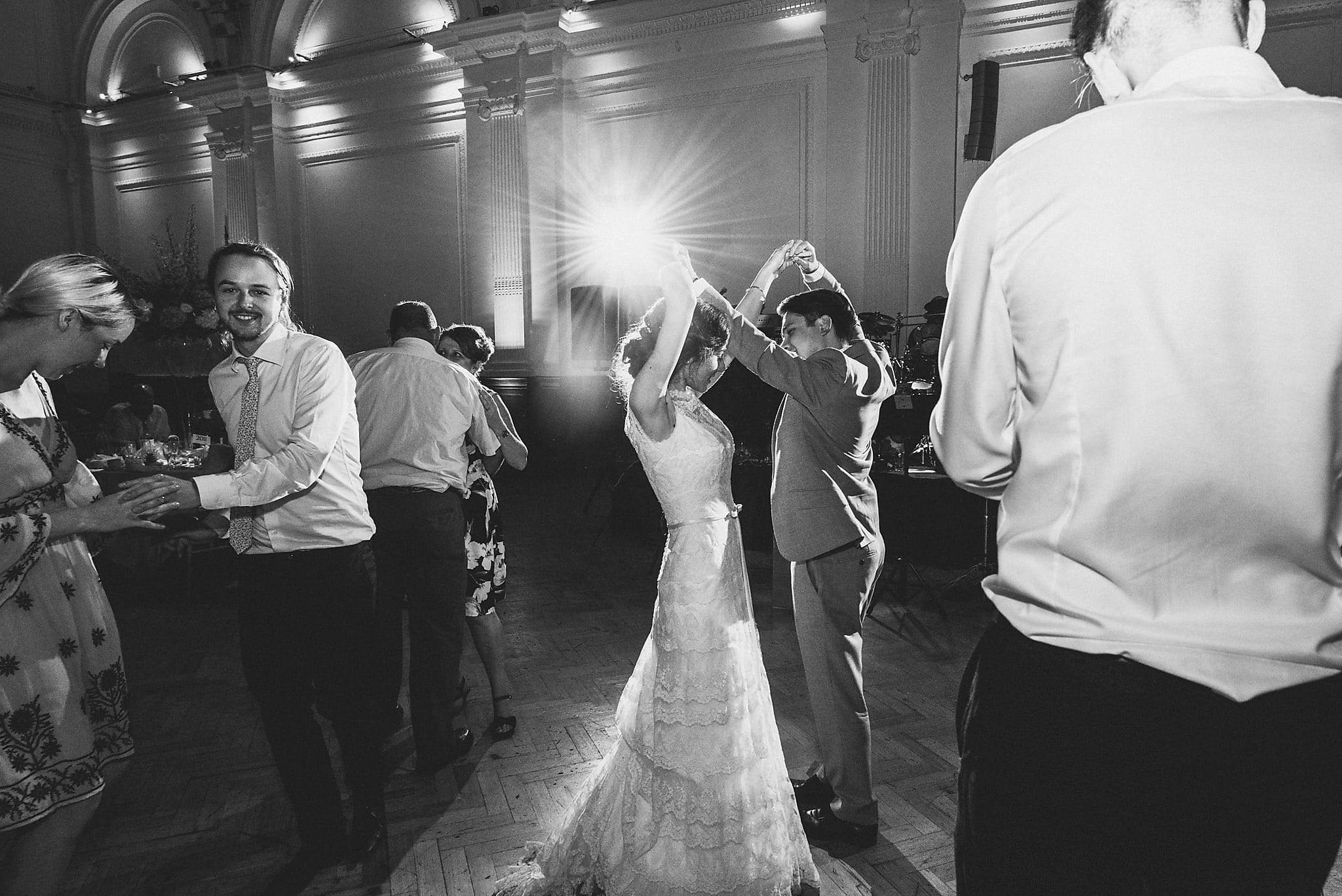 Black and white shot of bride and groom on dancefloor