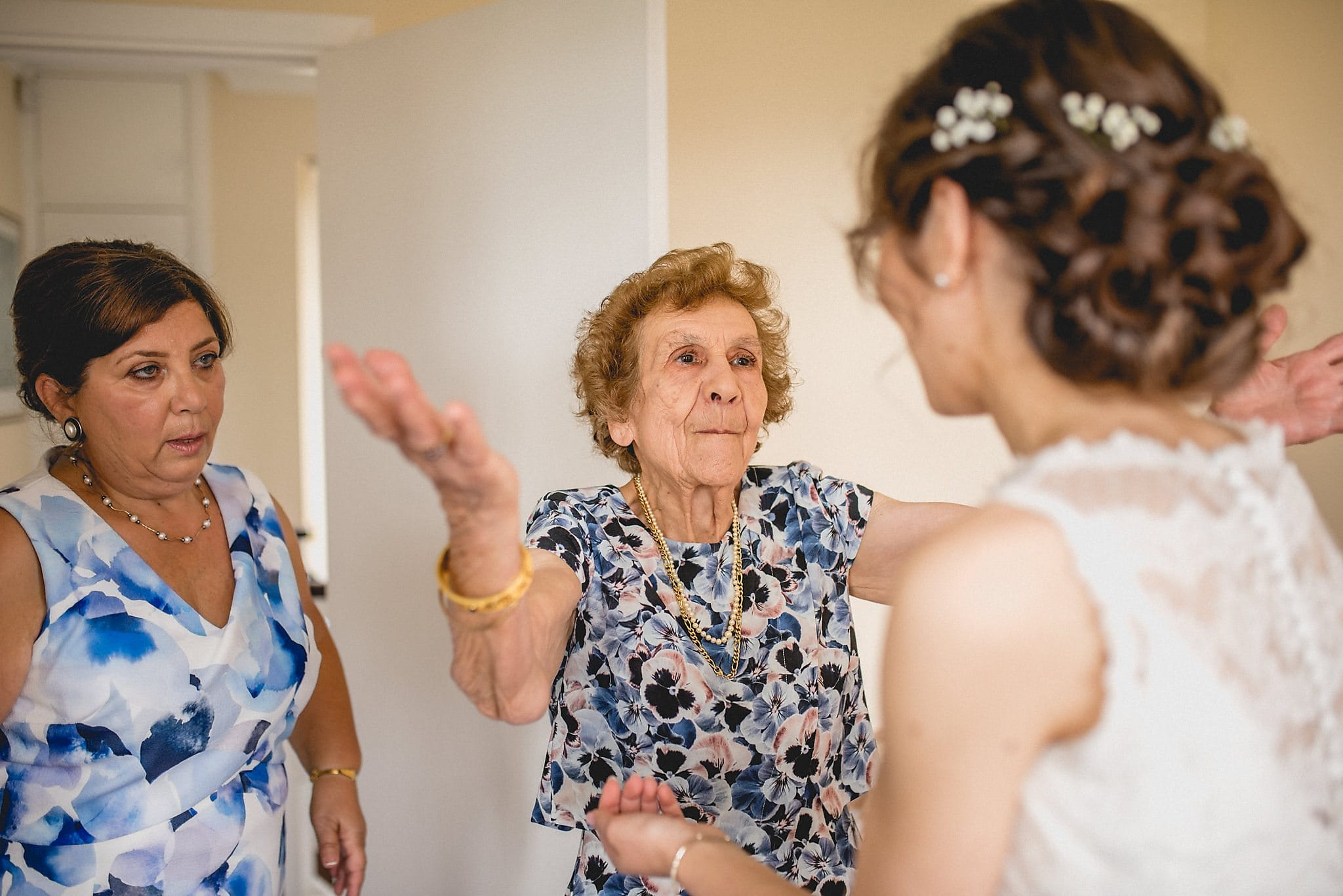 Bride is greeted by her grandmother as she gets ready for her wedding