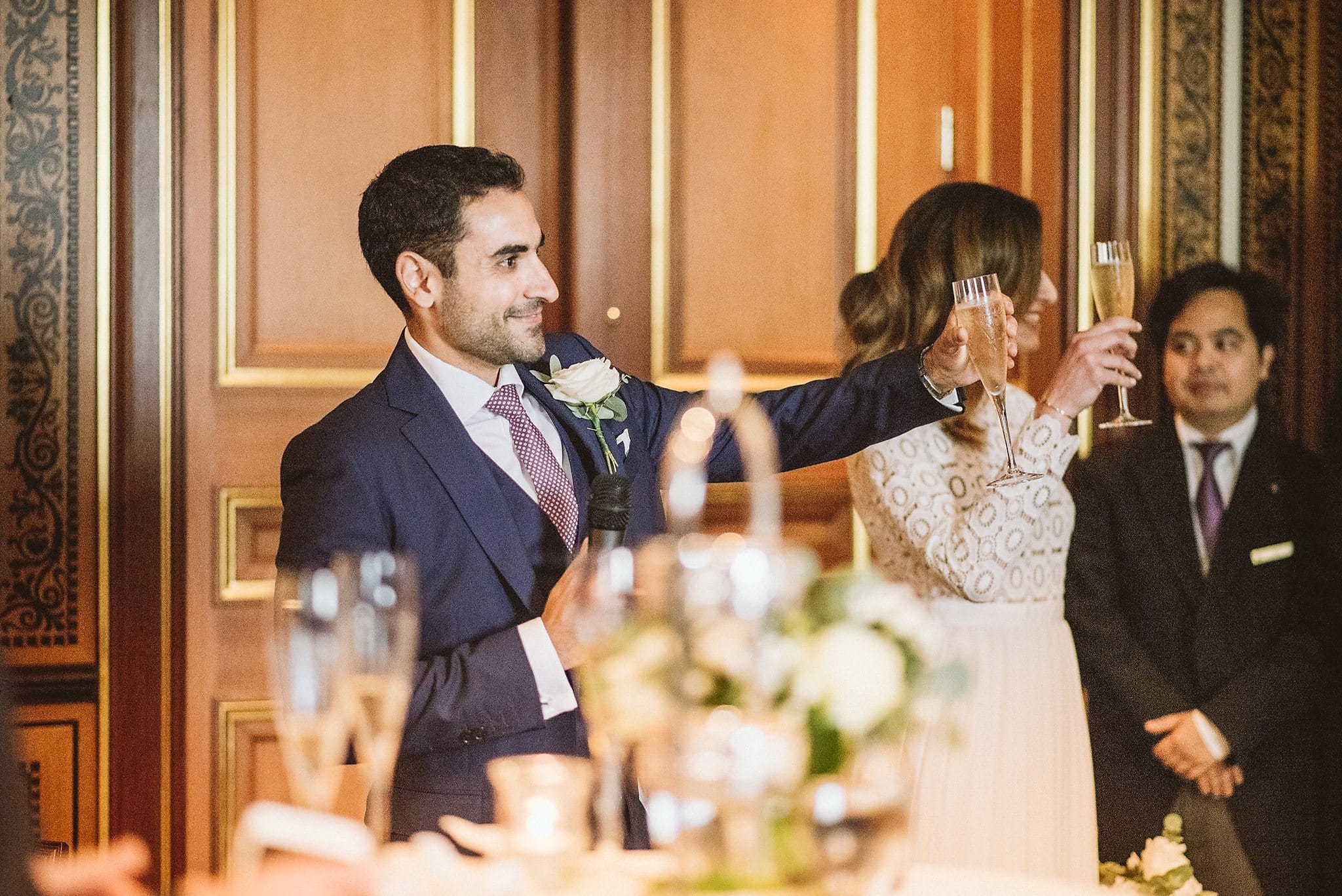 Bride and groom raise a glass during the speeches at their Lanesborough wedding