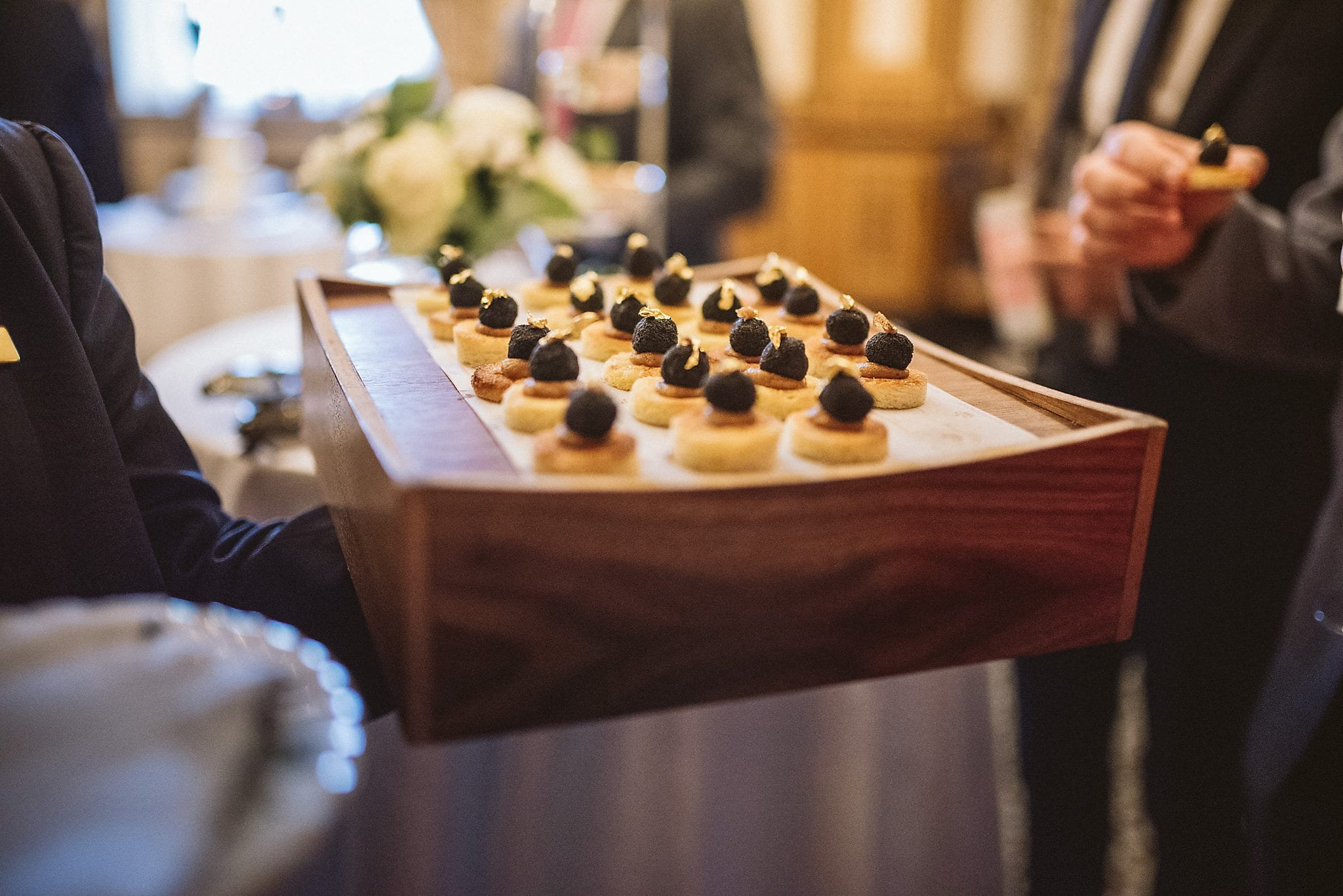 Tray of canapés with gold leaf topping at The Lanesborough wedding