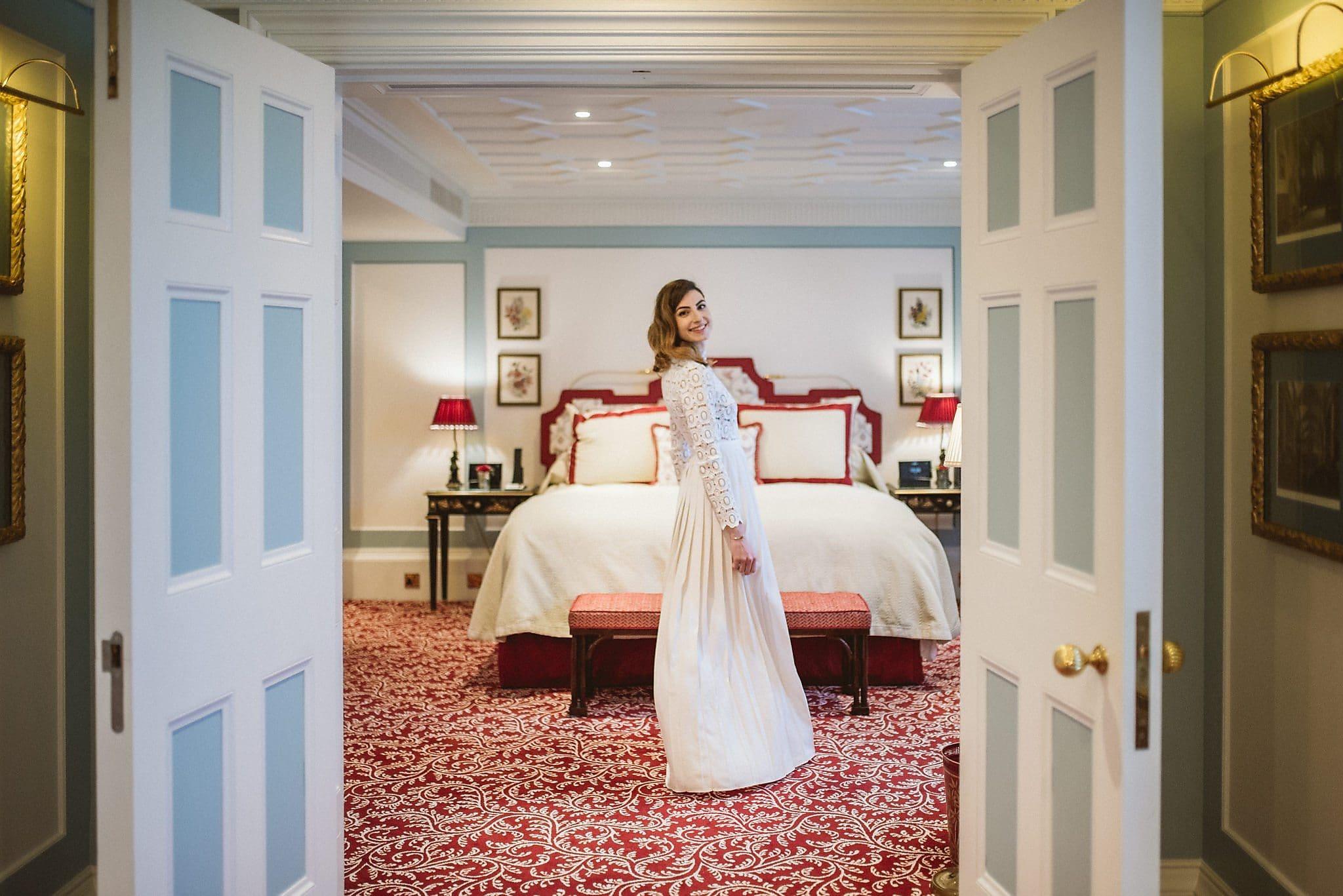 Bride in wedding dress twirls in bridal suite at her Lanesborough wedding