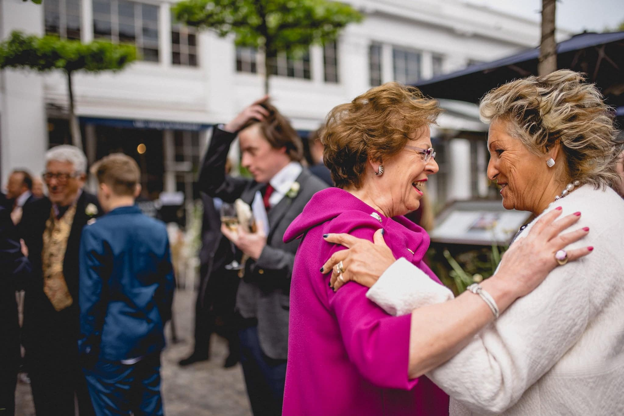 Guests embrace at relaxed Chelsea Bluebird wedding