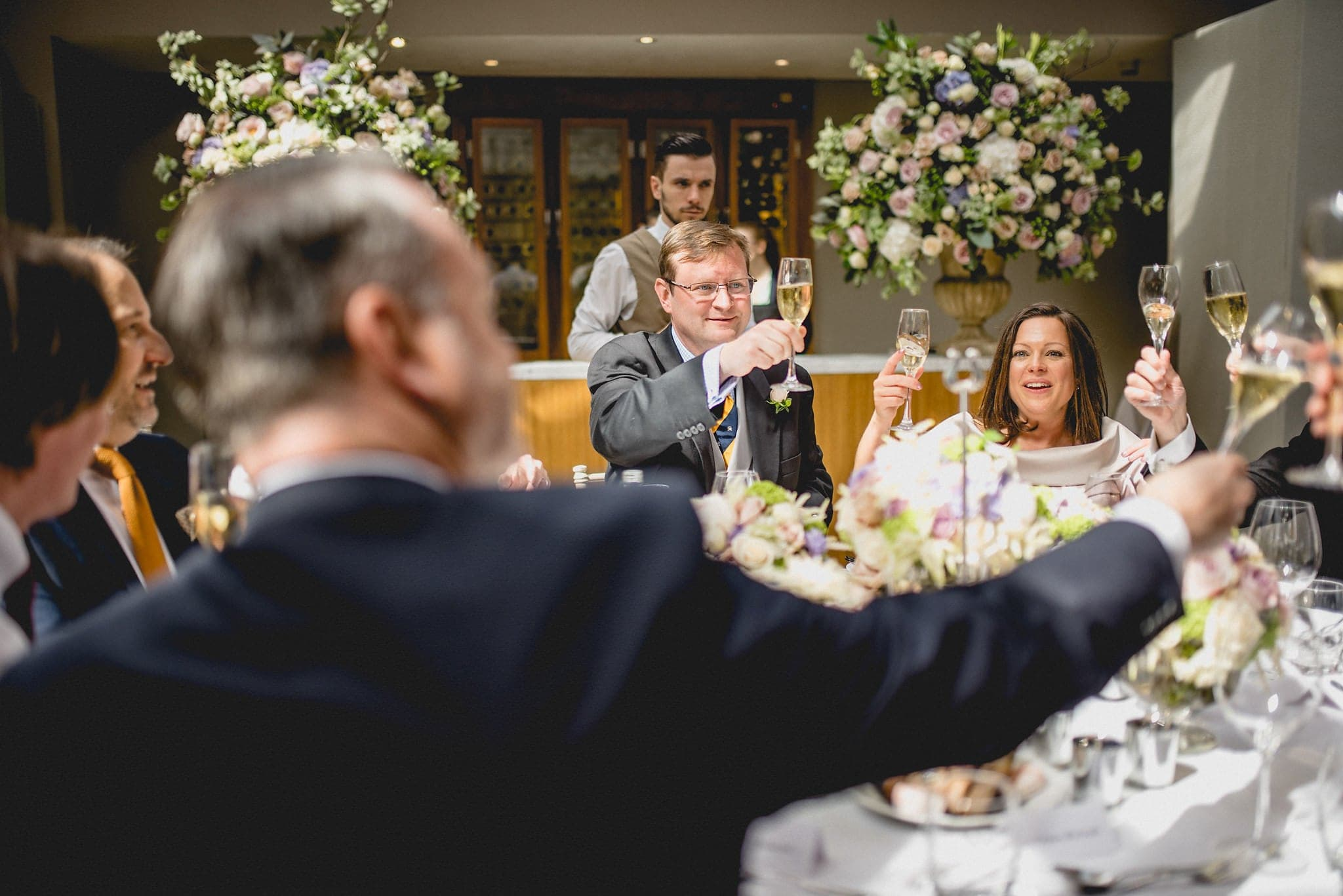 Bride, groom and guests raise a toast