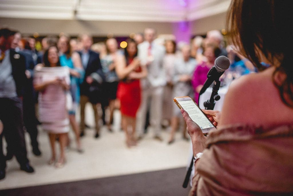 Guest reads speech from iPhone