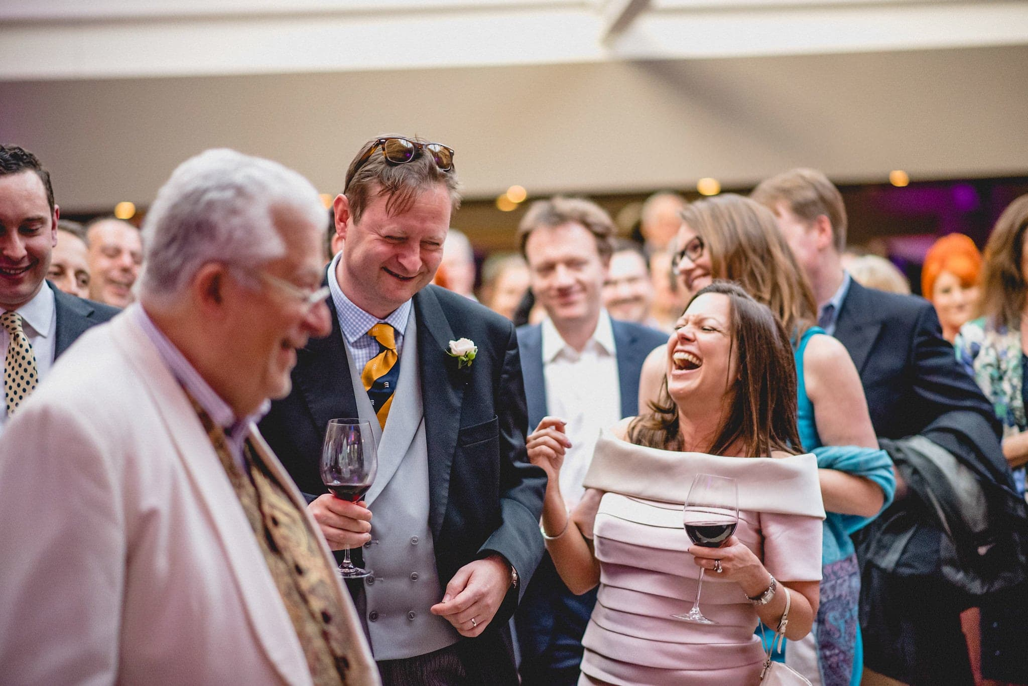 Bride bursts out laughing at her wedding reception