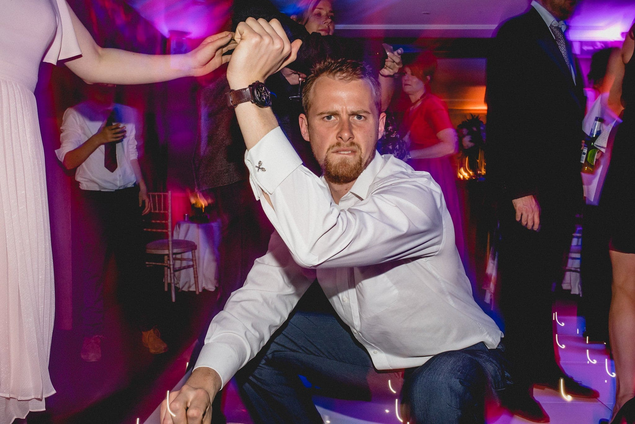 Male wedding guest shows off his moves on the dance floor