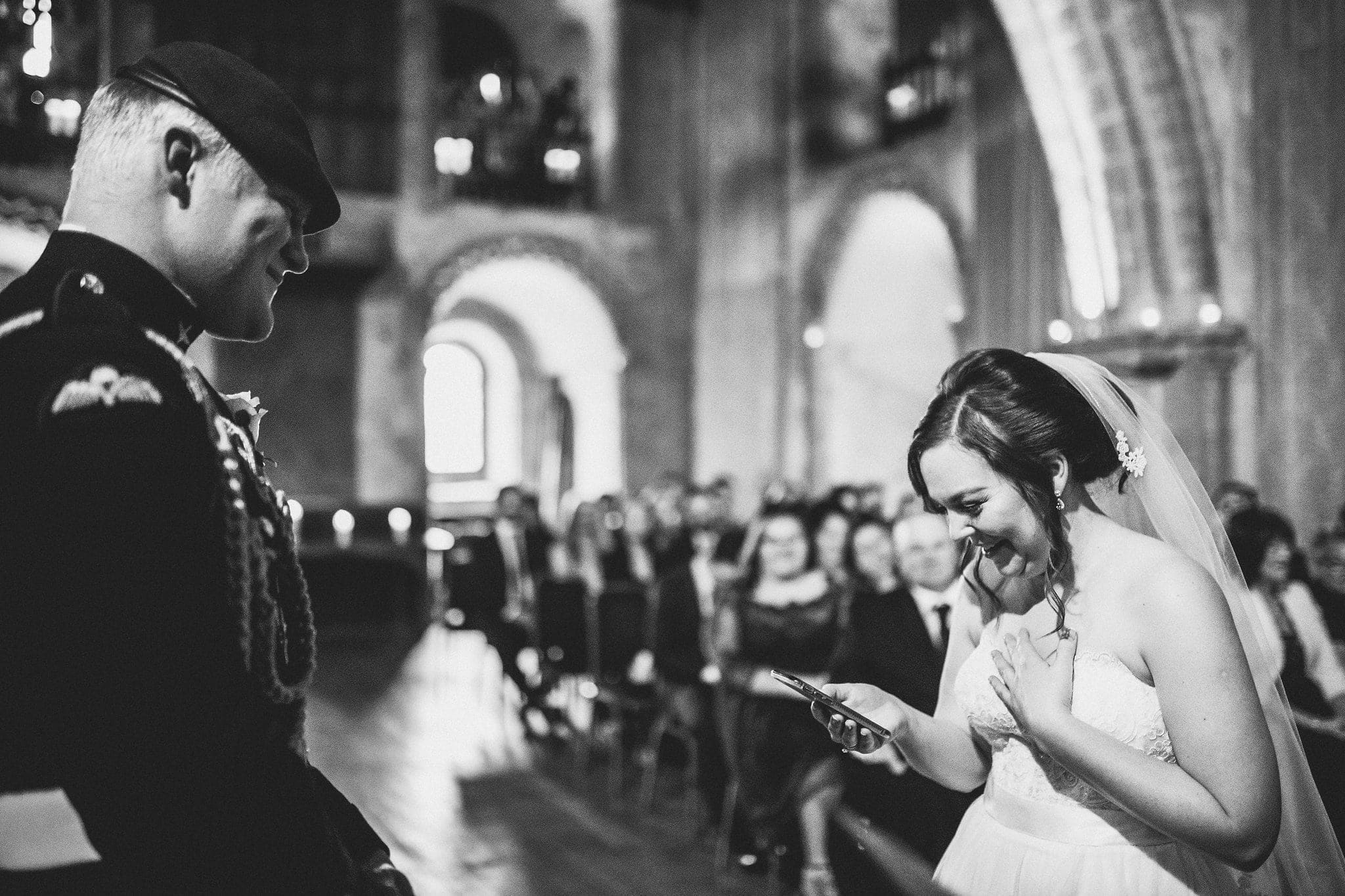 Bride reads from smart phone during ceremony