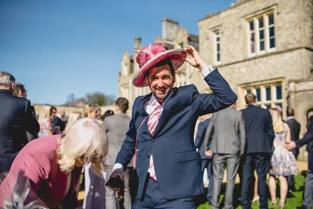 Male guest tries on pink hat