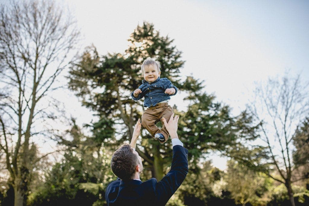 Guest throws laughing toddler into the air