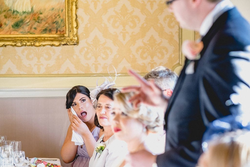 Bridesmaid wipes eyes during wedding speech