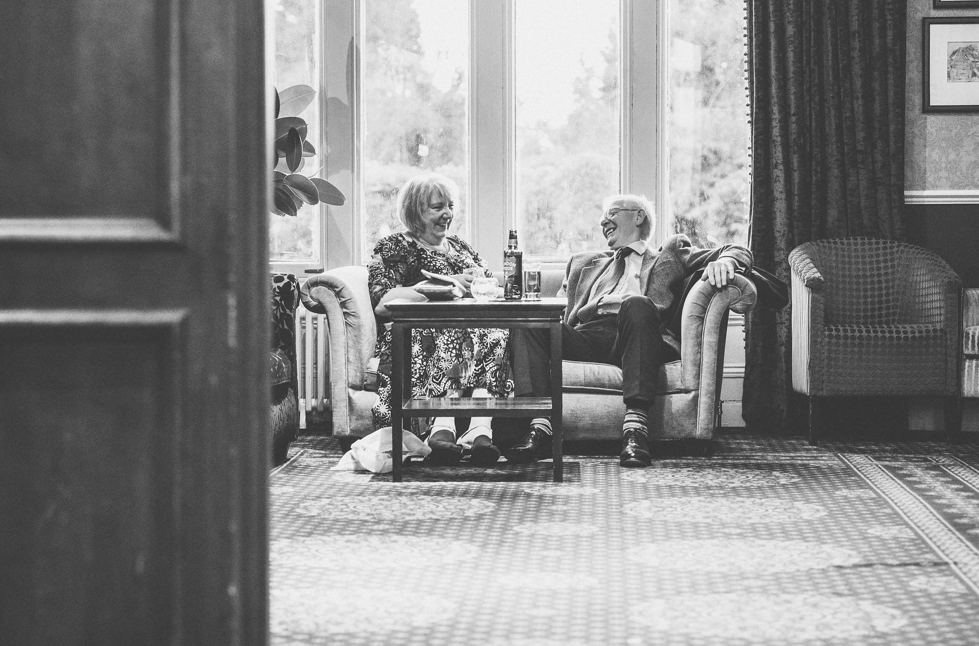 Guests relax together on the sofa at wedding reception