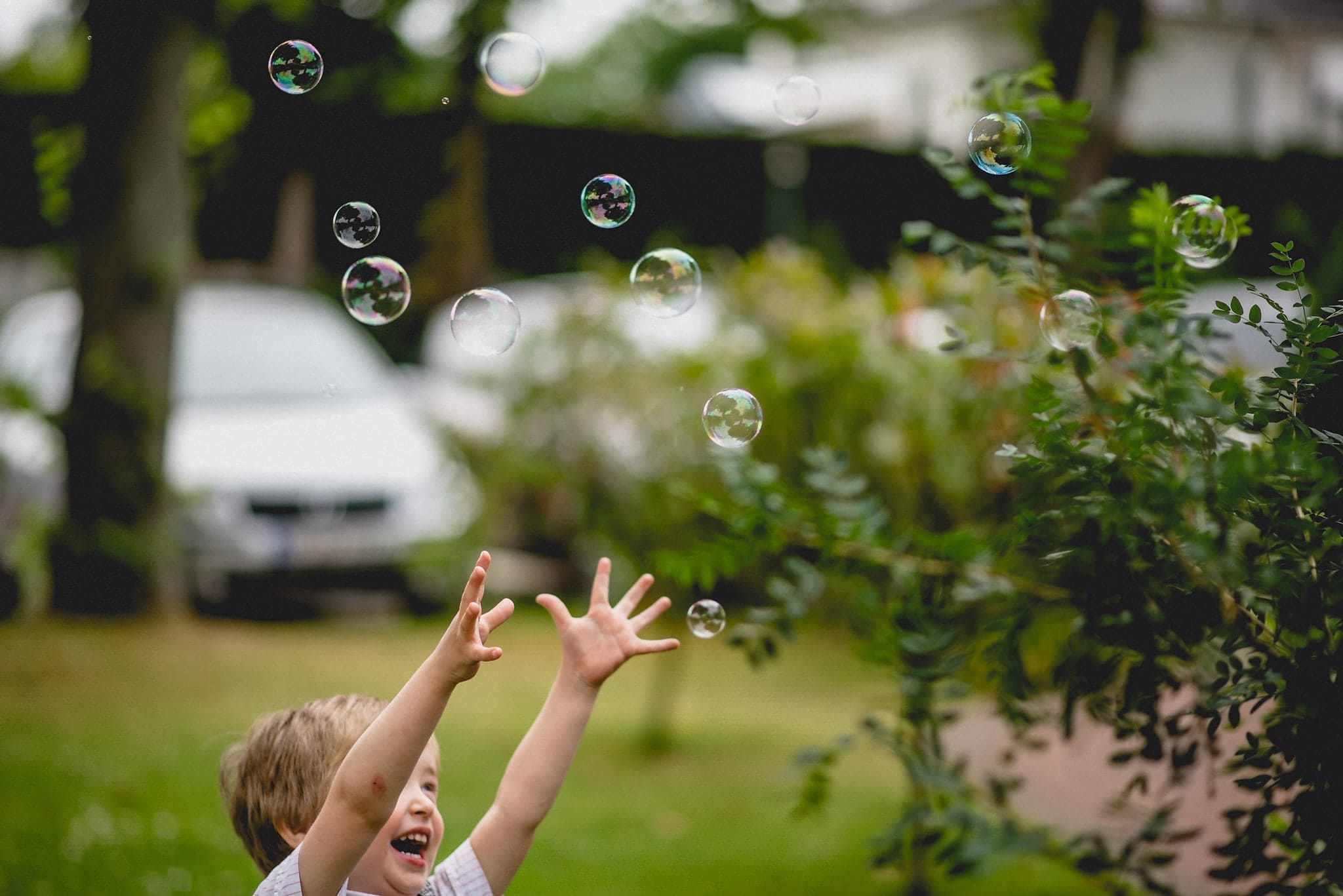 kid chasing bubbles