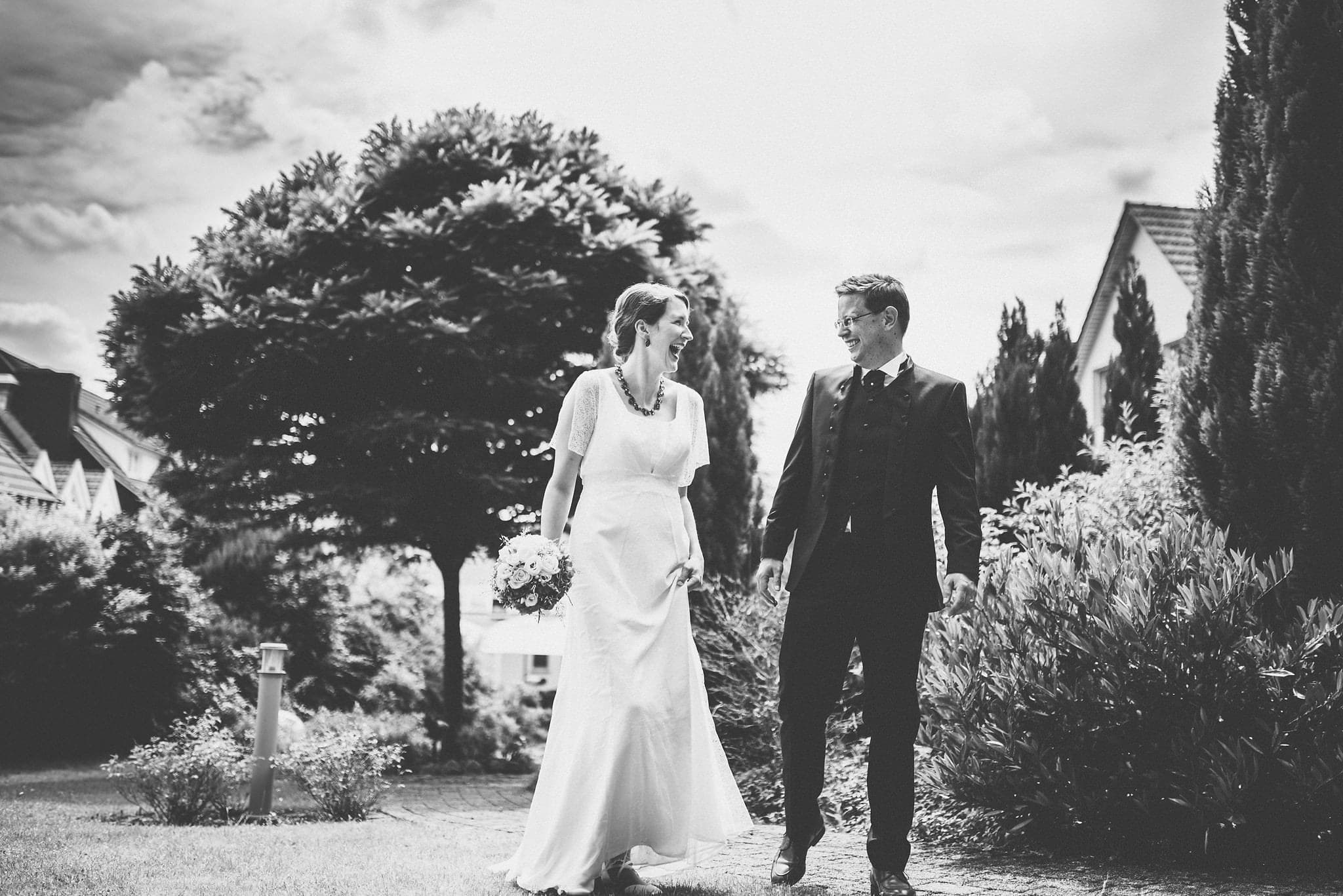 Bride and groom walking and laughing at their Heartfelt Destination Wedding in Germany | Maria Assia Photography
