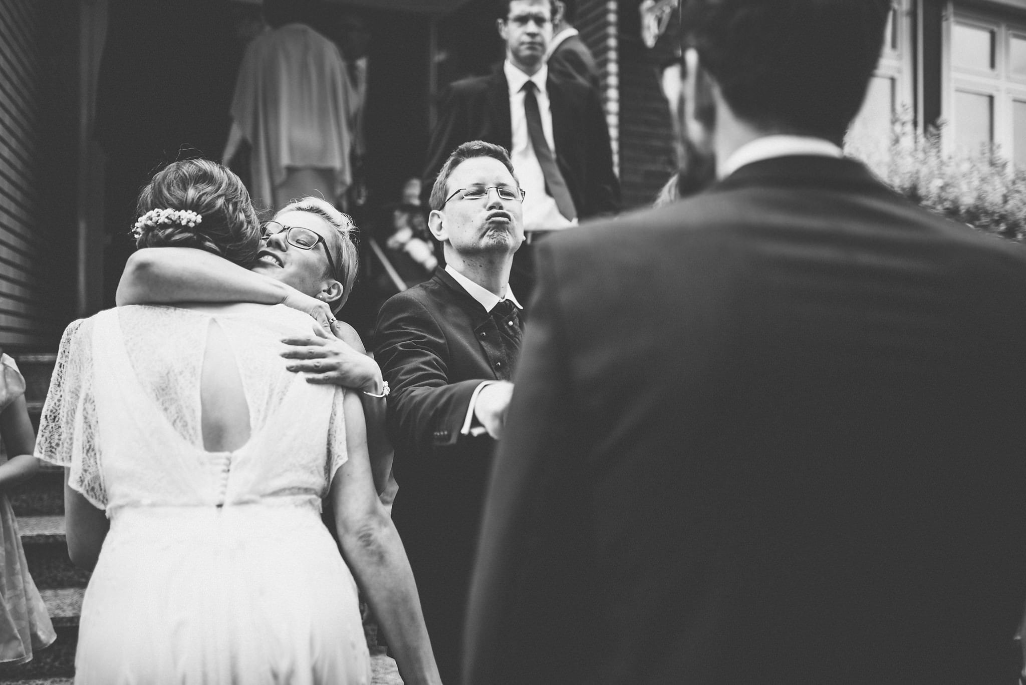 Documentary Wedding Photography by Maria Assia Photography of the bride and groom greeting their wedding guests
