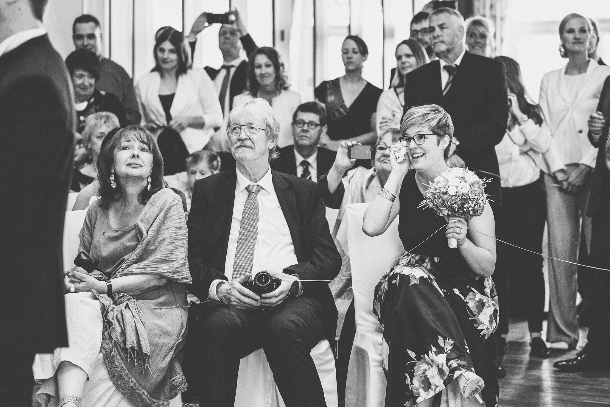 Wedding guests tearing up at a Heartfelt Destination Wedding in Germany