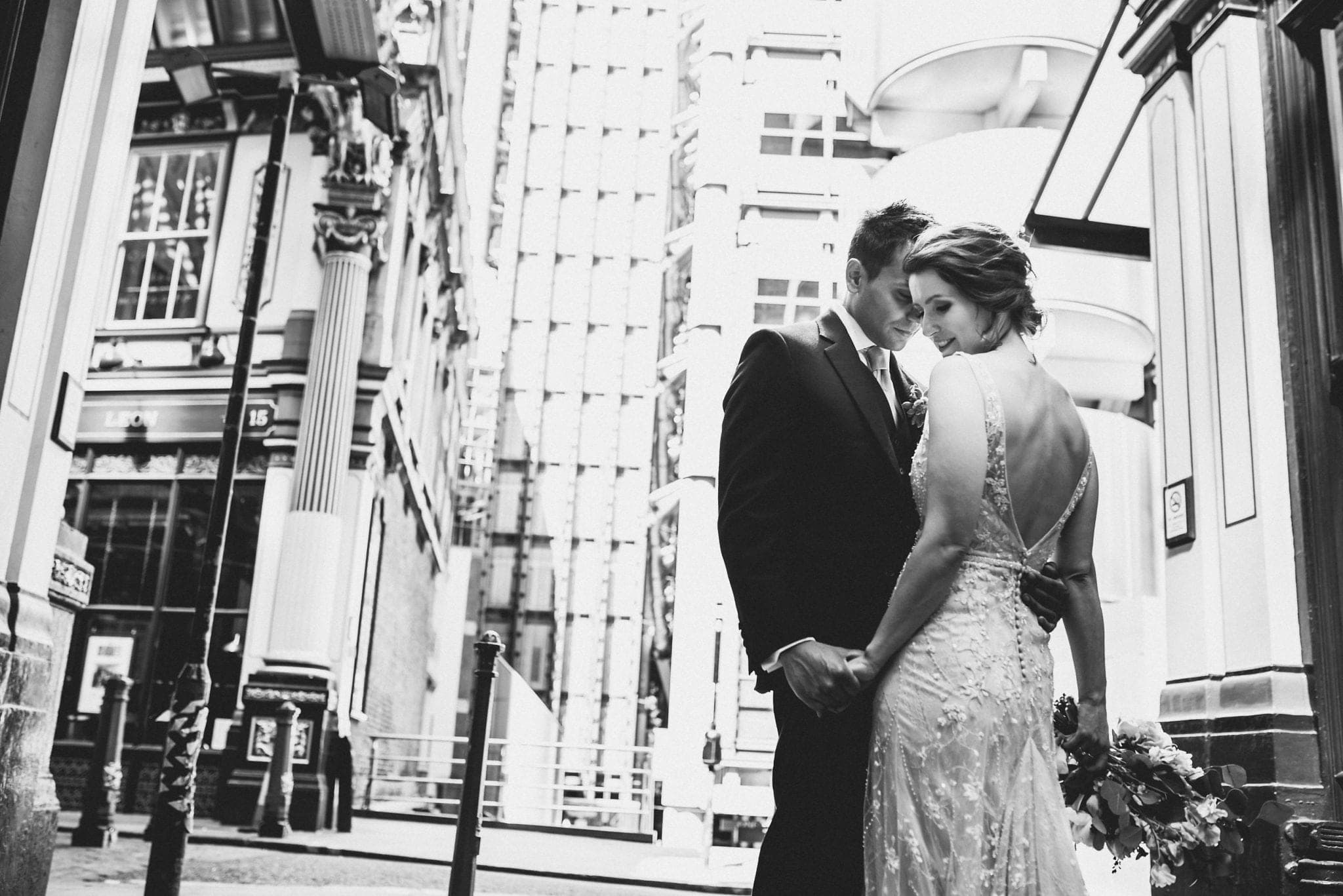 Black and white portrait of bride and groom on London street