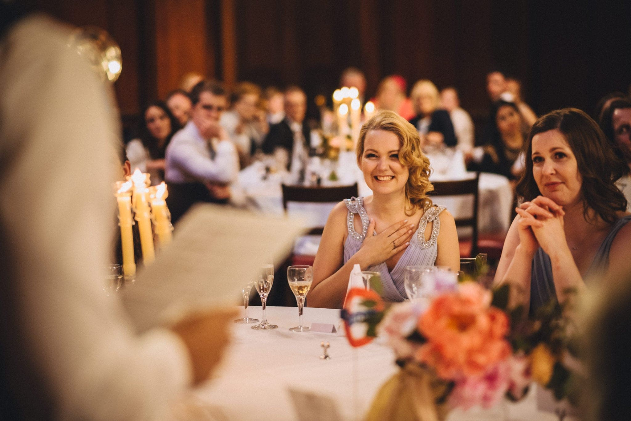 Bridesmaid puts hand on heart during speeches