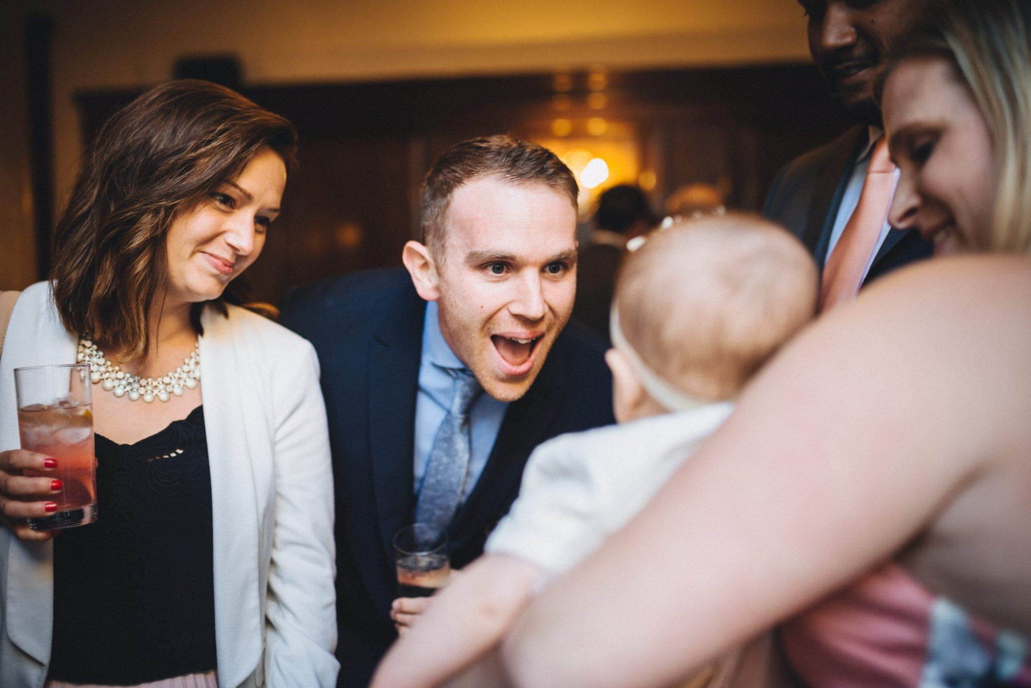 Guests smile at a baby