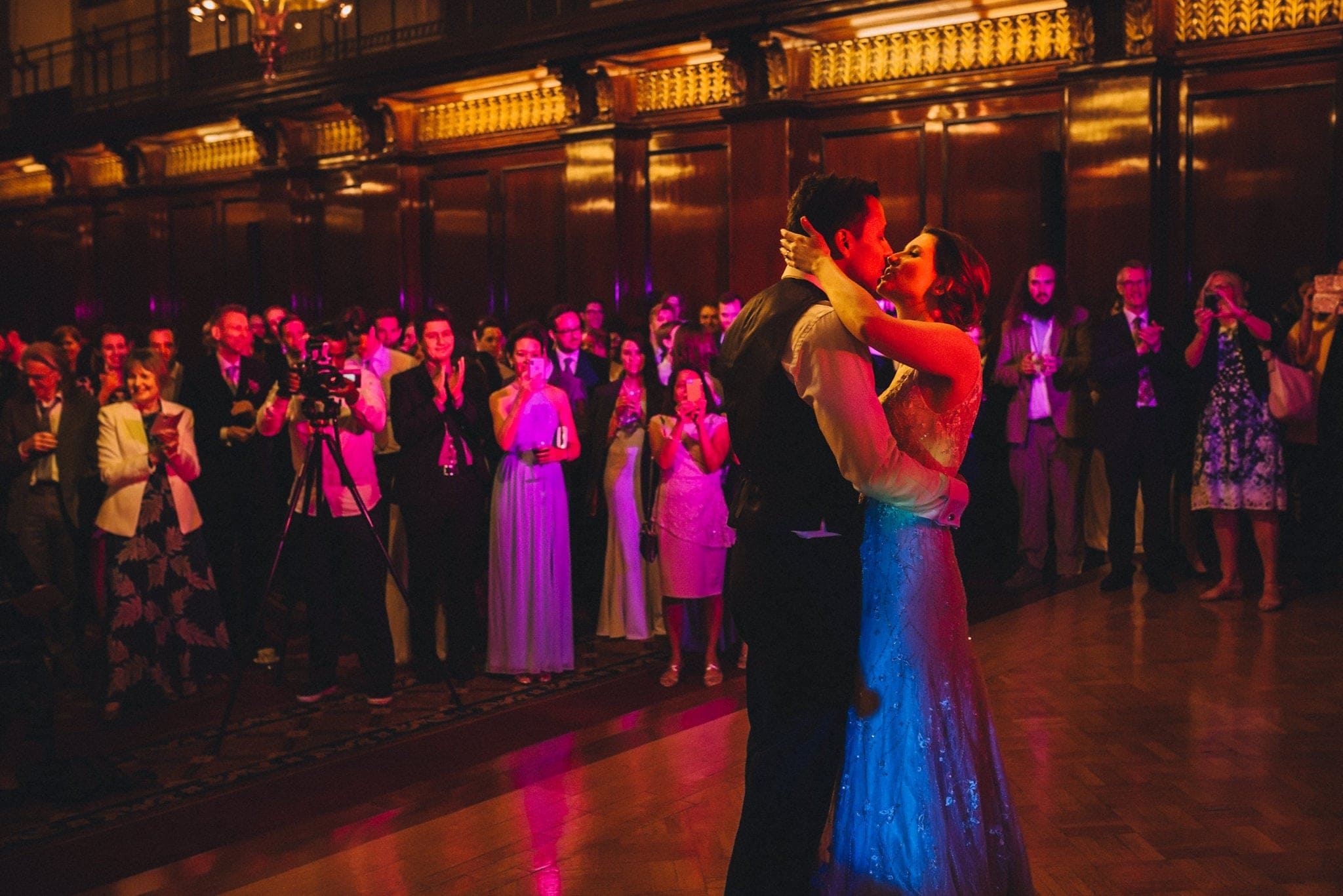 First dance with coloured lights at relaxed London wedding