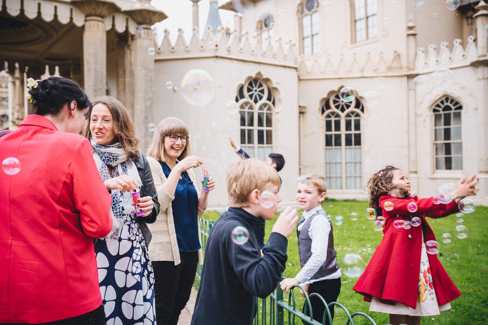 Kids chase bubbles outside Brighton Royal Pavilion Wedding