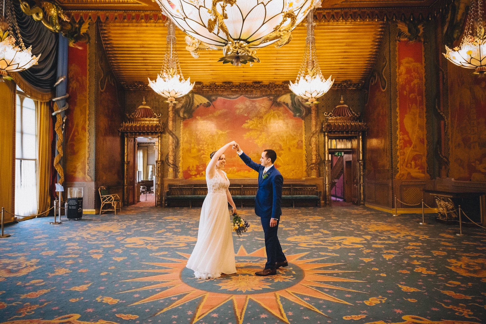 Groom twirls his bride in Royal Pavilion ballroom in Brighton