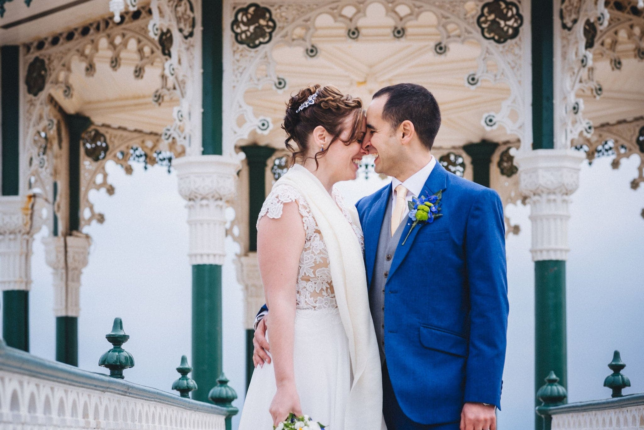 Bride and groom embrace on Brighton bandstand